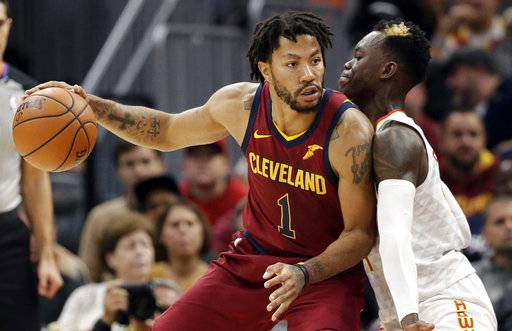 FILE - In this Nov. 5, 2017, file photo, Cleveland Cavaliers' Derrick Rose, left, drive against Atlanta Hawks' Dennis Schroder (17), from Germany, in the first half of an NBA basketball game in Cleveland.Cavaliers guard Derick Rose revealed he has a bone spur in his left ankle contributed to him leaving the team. Rose left the Cavs on Nov. 22 and only returned this week, Friday, Dec. 8, 2017. (AP Photo/Tony Dejak, File)