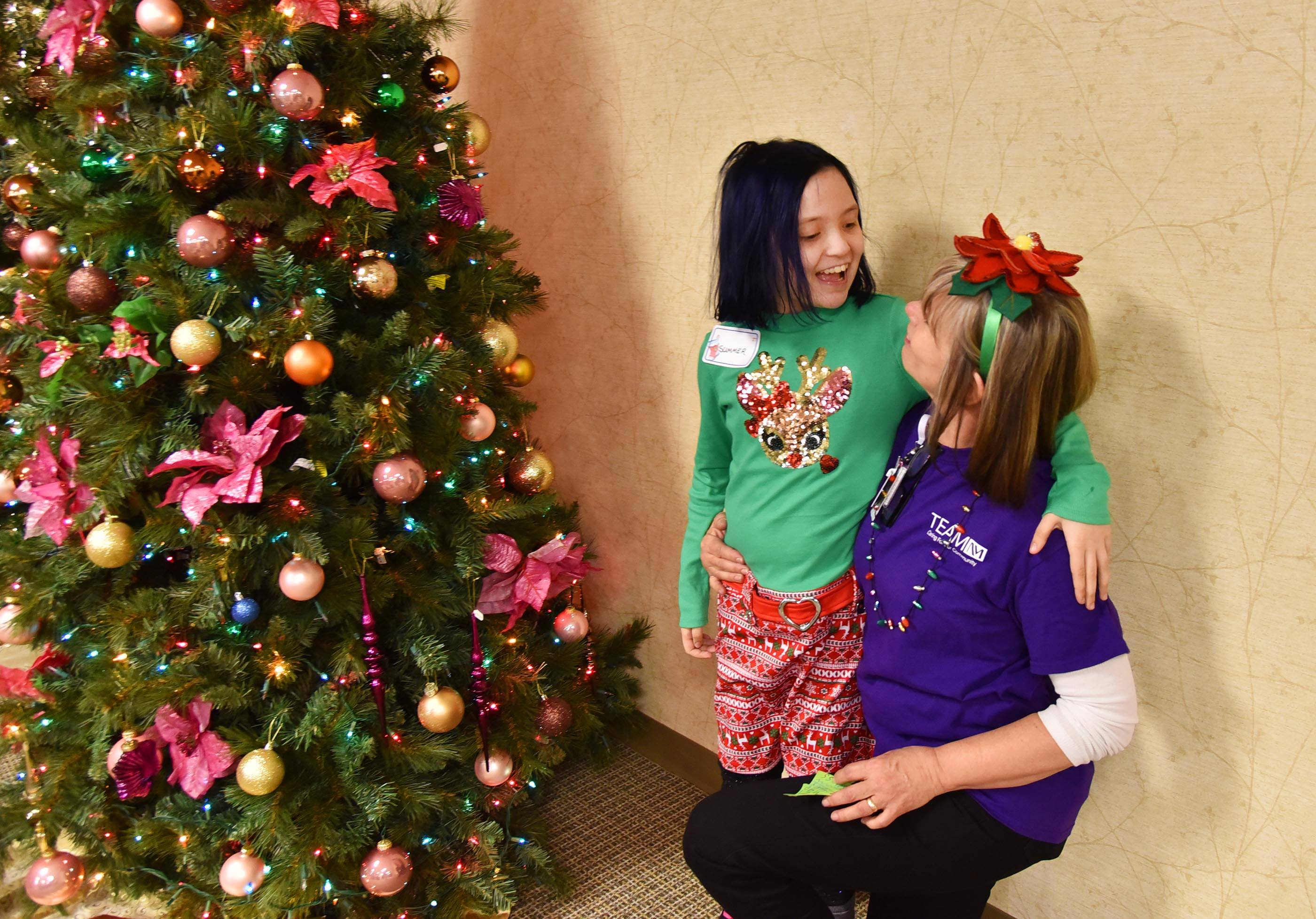 Summer Chylewski, 10, of Lombard visits with physical therapist Ginny Girton Saturday at the Marianjoy Rehabilitation Hospital in Wheaton.