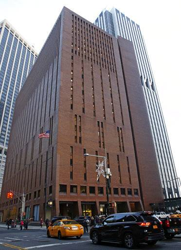 In this Dec. 4, 2017, photo, 4 New York Plaza, where American Media Inc., has its headquarters in New York City. An Associated Press investigation reveals that the top editor at National Enquirer publisher American Media Inc., Dylan Howard, who previously faced allegations of sexual misconduct at the gossip news giant, was also accused of harassing behavior at another employer. He resigned from the startup celebrity news site Celebuzz in 2013 amid a human resources investigation, after he had already left American Media's Los Angeles office in 2012 amid allegations of sexual harassment. (AP Photo/Kathy Willens)
