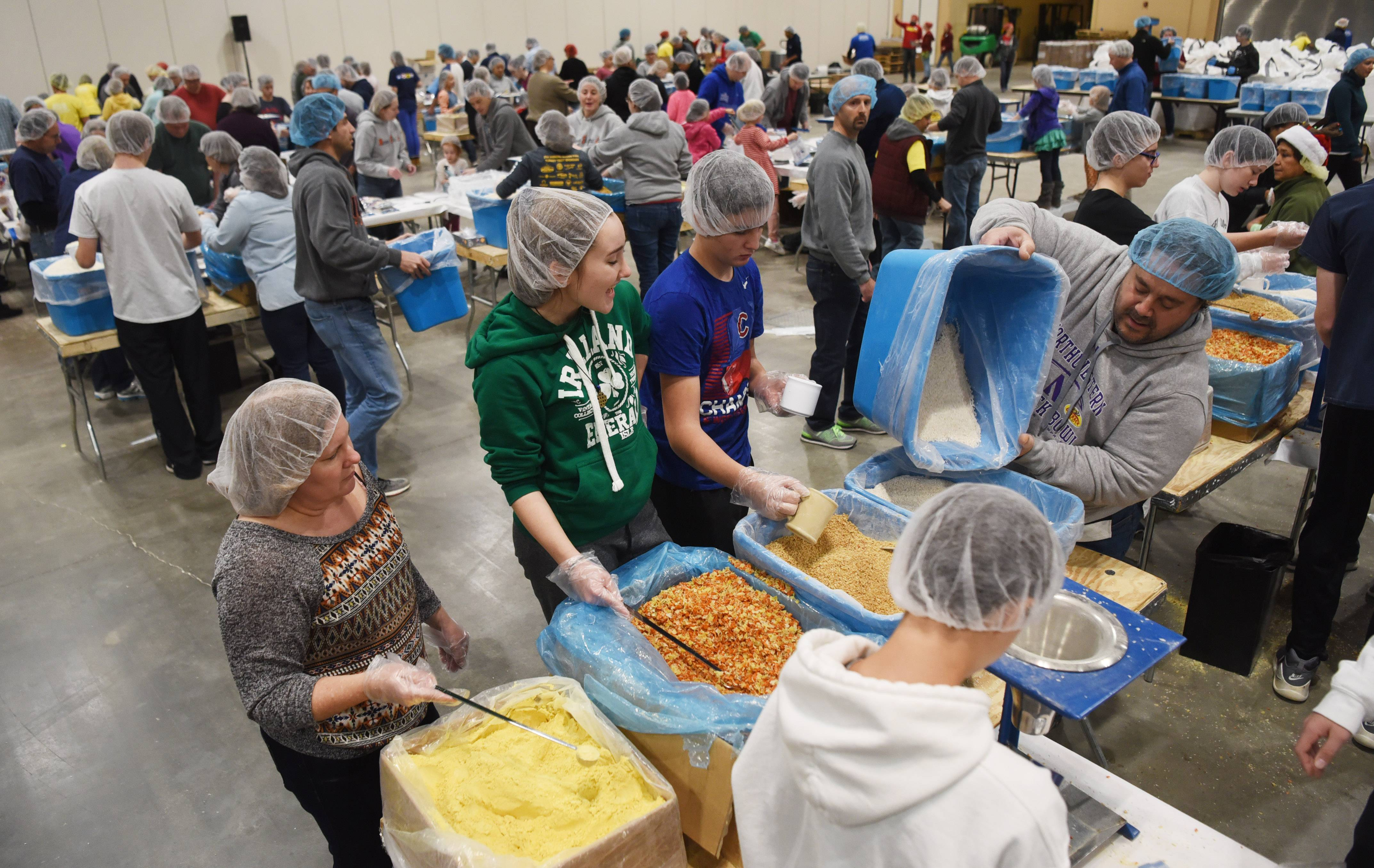 A group from St. Viator High School in Arlington Heights took park in Feed My Starving Children's Hope Filled Holiday MobilePack event Sunday at the Renaissance Schaumburg Convention Center.