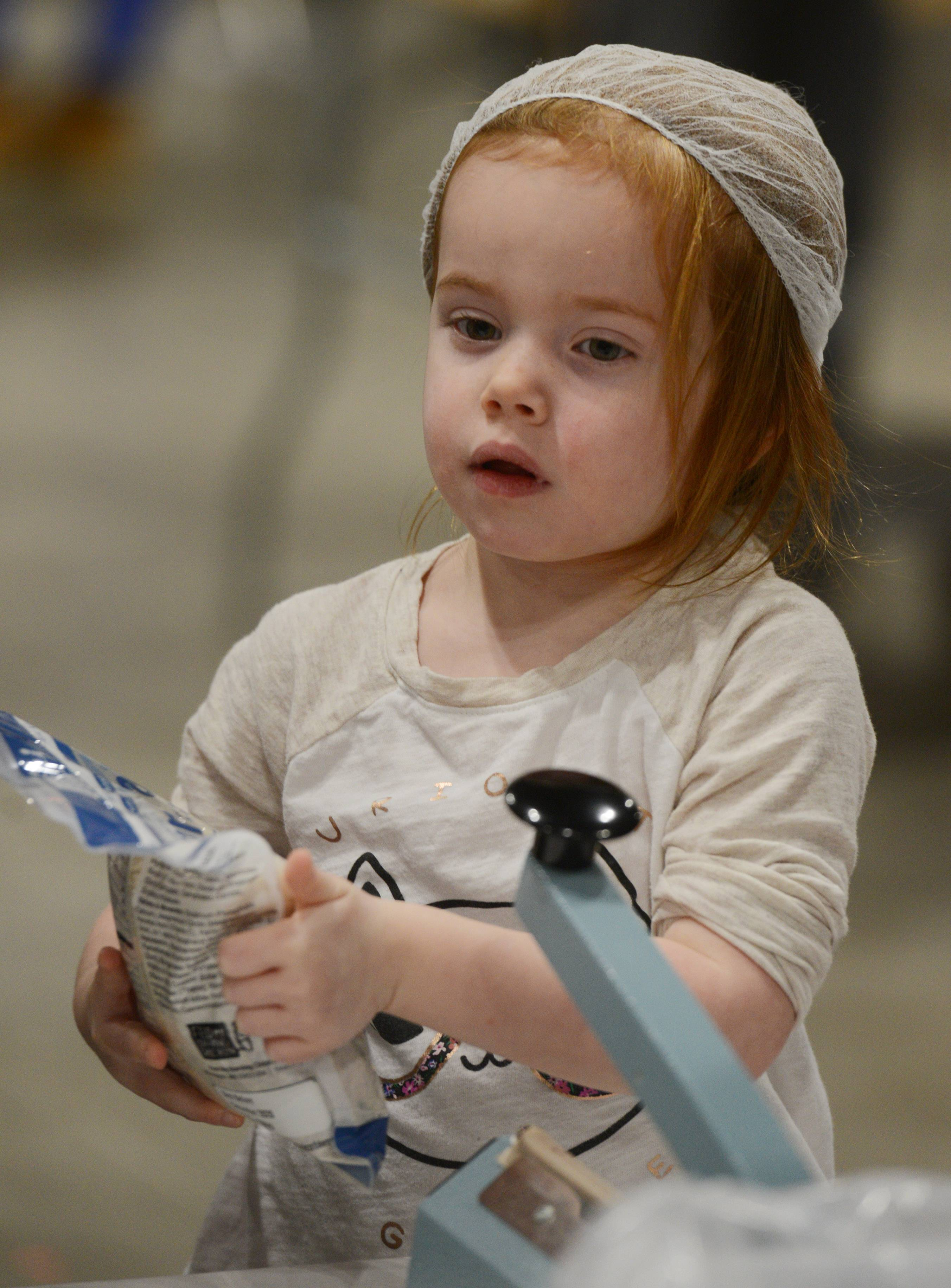 Feed My Starving Children volunteer Ivy Meersman, 5, of Chicago took park in an effort to pack 1 million meals over the weekend during Feed My Starving Children's Hope Filled Holiday MobilePack event at the Renaissance Schaumburg Convention Center.