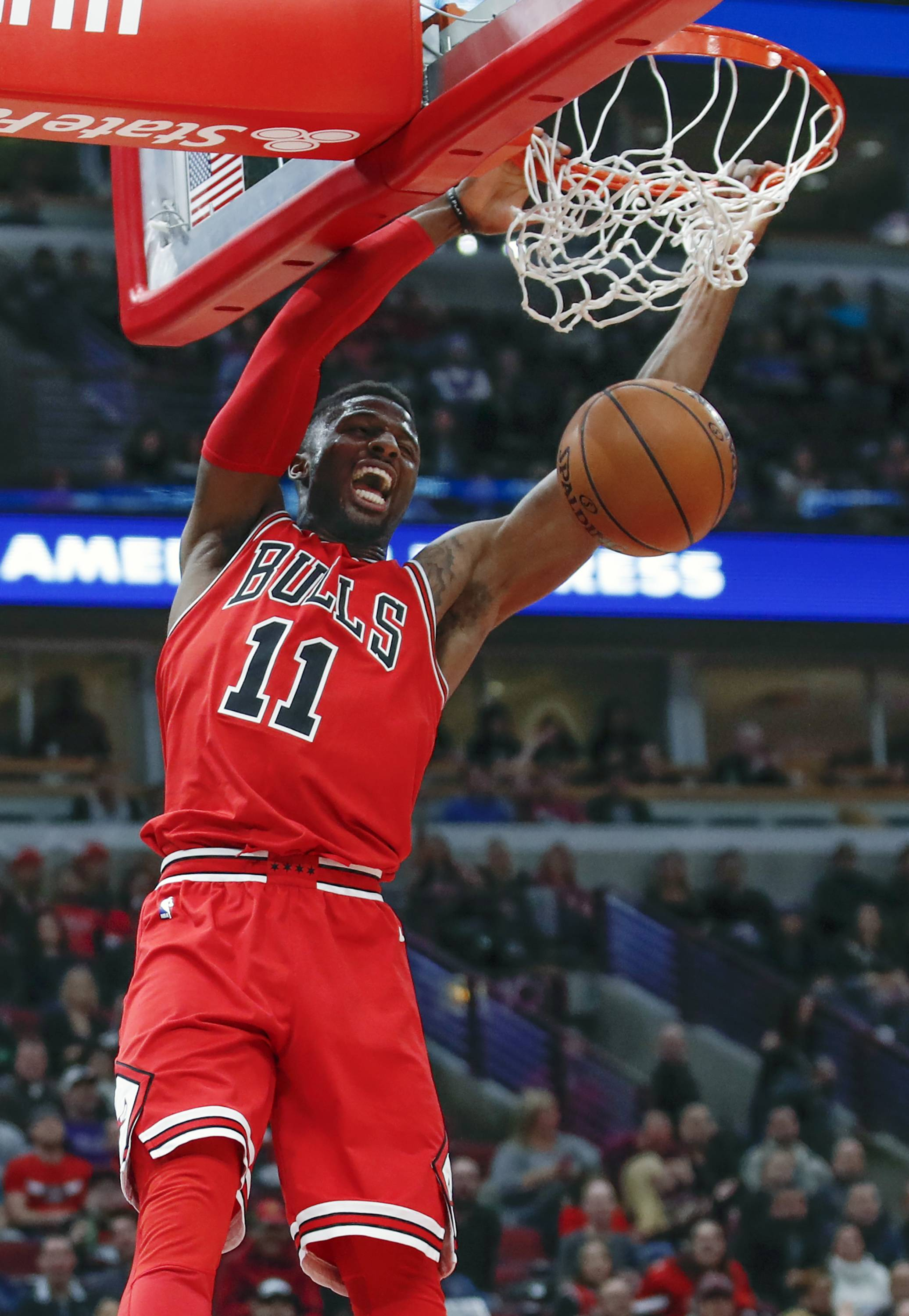 Chicago Bulls guard David Nwaba dunks against the New York Knicks during the second half of an NBA basketball game, Saturday, Dec. 9, 2017, in Chicago.