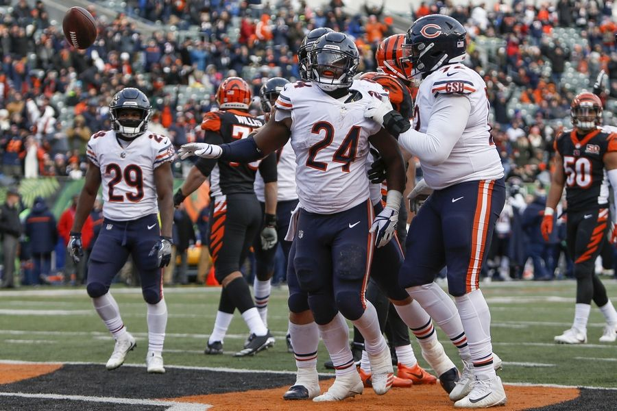 Chicago Bears running back Jordan Howard (24) flips the ball away after scoring a touchdown in the second half of an NFL football game against the Cincinnati Bengals, Sunday, Dec. 10, 2017, in Cincinnati.