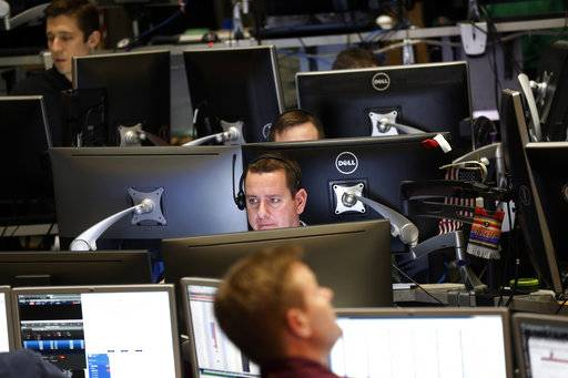 Traders work in a trading pit at the Chicago Board Options Exchange, Monday, Dec. 11, 2017, in Chicago, as they trade futures and options unrelated to bitcoin. Trading in bitcoin futures began Sunday on the CBOE.