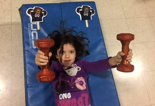 Third-grader Maddie Sempsrott works out during a Fuel Up to Play 60 fitness program at Richmond Intermediate School in St. Charles.