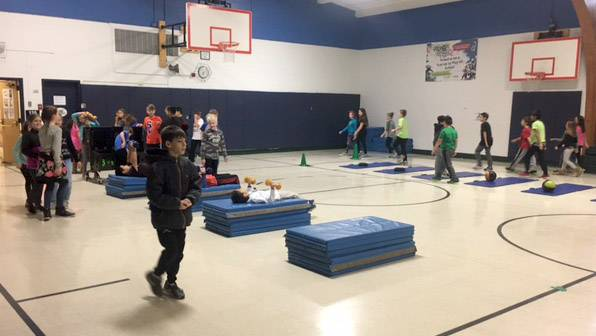 Students participate in a Fuel Up to Play 60 fitness and leadership program at Richmond Intermediate School in St. Charles. Gus Silva, a dean at the school, started it there about seven years ago.
