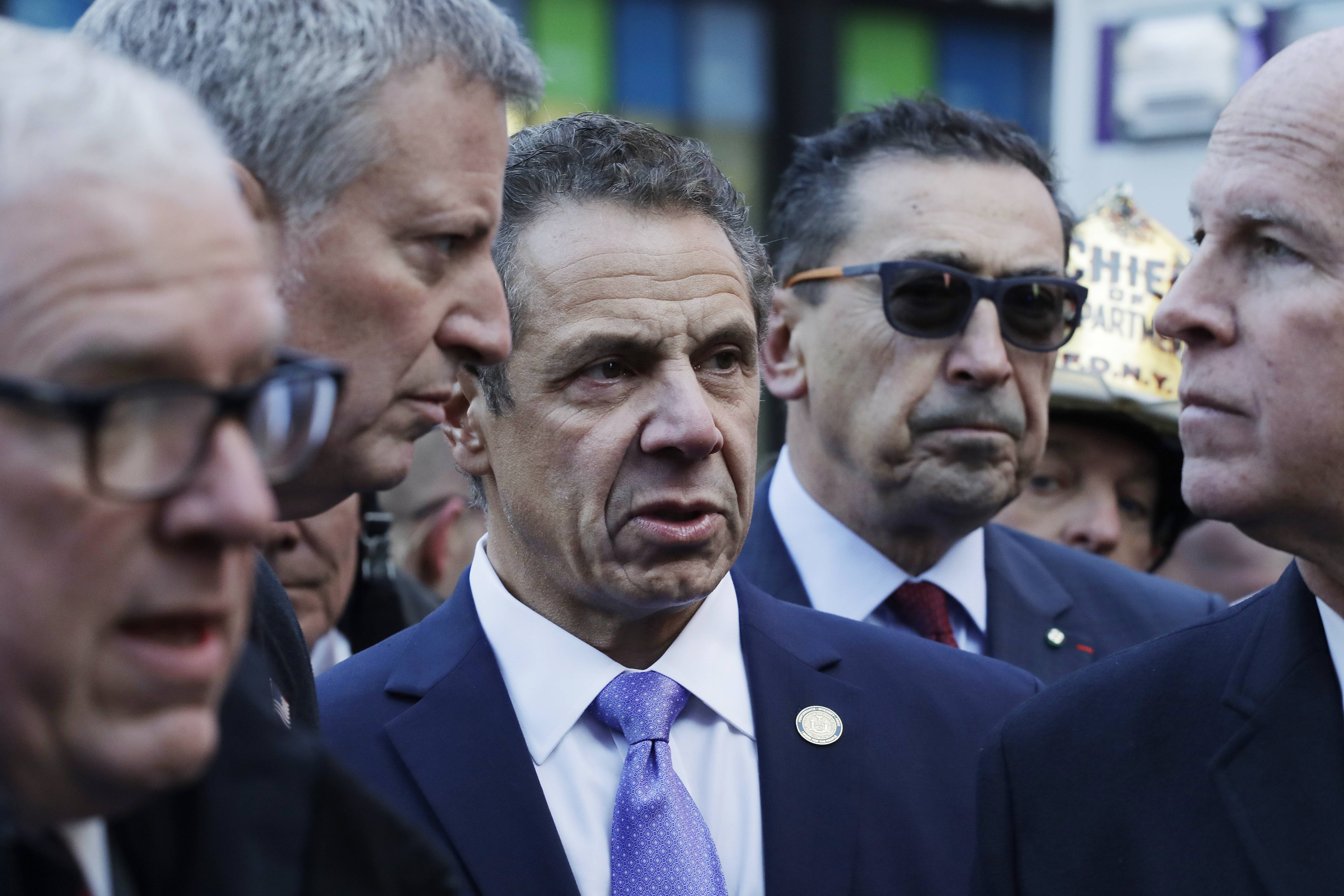 Attending a news conference Monday outside the Port Authority Bus Terminal are, from left, John Miller, deputy commissioner with the NYPD, Mayor Bill de Blasio, Gov. Andrew Cuomo, Fire Commissioner Daniel Nigro and Police Commissioner James O'Neill.