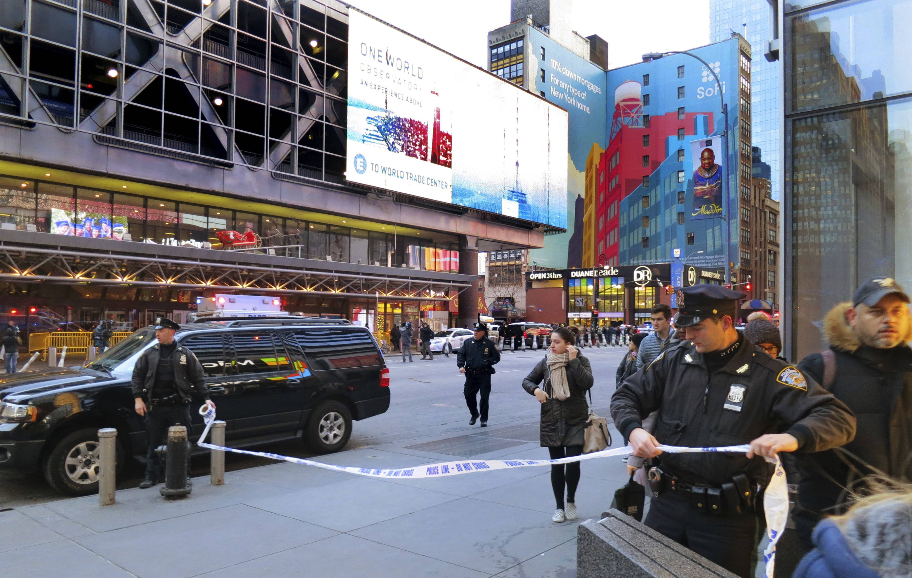 Police secure Eighth Avenue outside the Port Authority Bus Terminal following an explosion Monday near New York's Times Square.