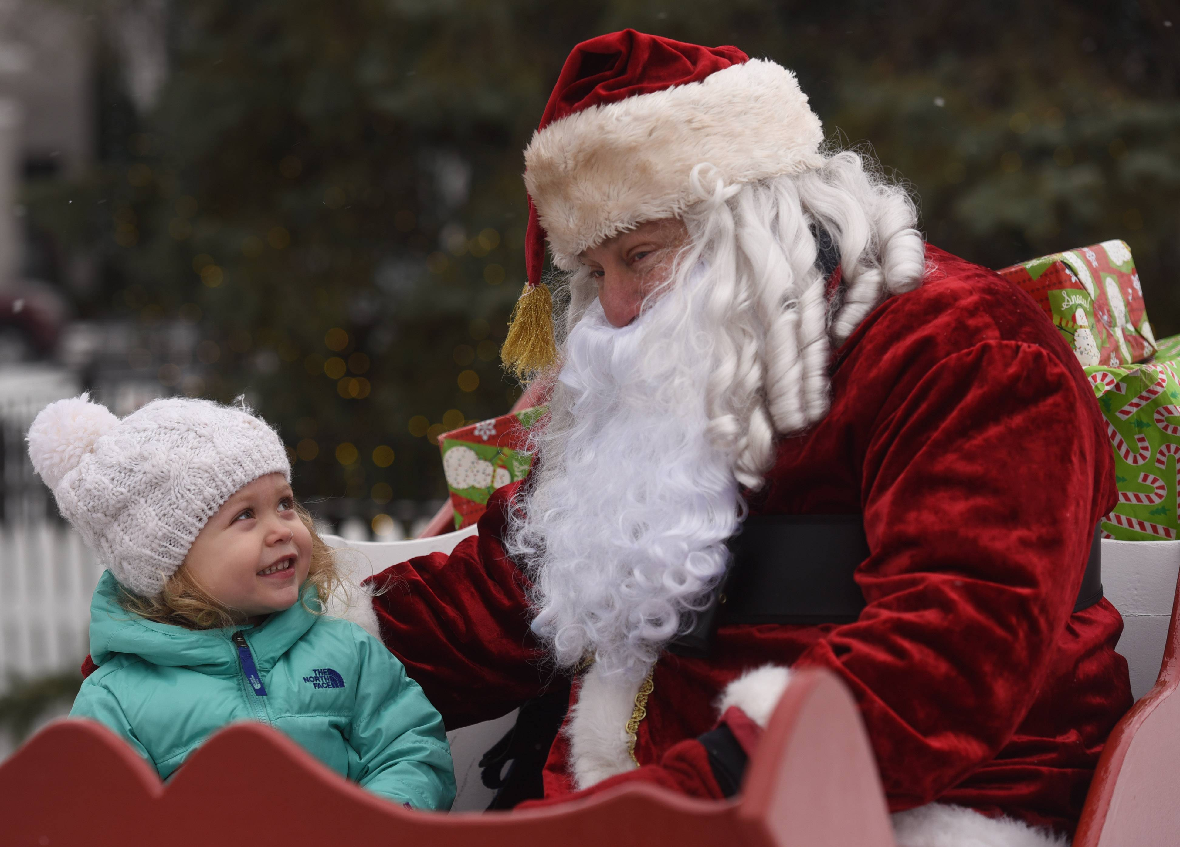 Katherine Yarbrough, 2-1/2, of Libertyville visits with Santa during the Dickens of a Holiday event in downtown Libertyville Saturday.