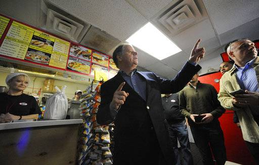 Democratic U.S. Senate candidate Doug Jones speaks to the media during a campaign stop at Chris Z's in Birmingham, Ala., on Monday, Dec. 11, 2017. Jones accused Republican nominee Roy Moore of hiding in the final days of the race.