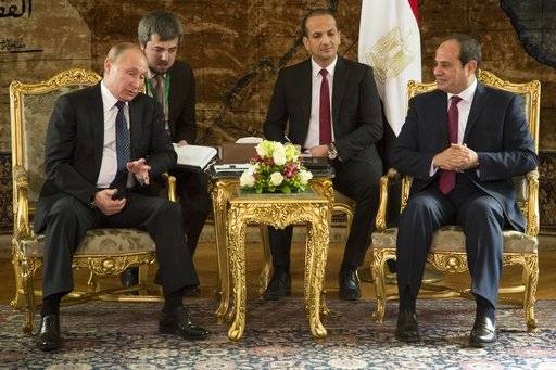 Russian President Vladimir Putin, left, speaks to Egyptian President Abdel-Fattah El-Sissi, during their meeting in Cairo, Egypt, Monday, Dec. 11, 2017.