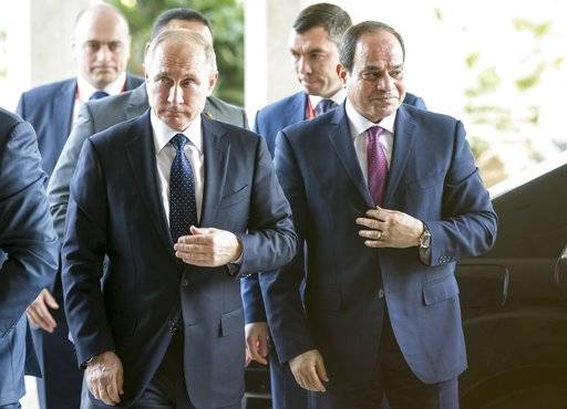 Russian President Vladimir Putin, left, and Egyptian President Abdel-Fattah El-Sissi, arrive to their talks in Cairo, Egypt, Monday, Dec. 11, 2017.