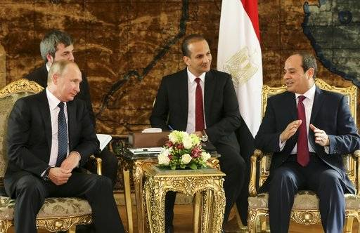 Russian President Vladimir Putin, left, listens to Egyptian President Abdel-Fattah El-Sissi, during their meeting in Cairo, Egypt, Monday, Dec. 11, 2017.
