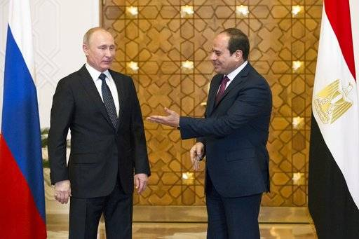 Egyptian President Abdel-Fattah El-Sissi, right, welcomes Russian President Vladimir Putin for the talks during their meeting in Cairo, Egypt, Monday, Dec. 11, 2017.