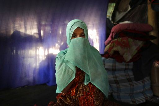 In this Wednesday, Nov. 22, 2017, photo, F, 22, pregnant, prays in her tent in Kutupalong refugee camp in Bangladesh. The Associated Press has found that the rape of Rohingya women by Myanmar's security forces has been sweeping and methodical. The AP interviewed 29 women and girls who say they were raped by Myanmar's armed forces, and found distinct patterns in their accounts, their assailants' uniforms and the details of the rapes themselves. The most common attack involved groups of soldiers storming into a house, beating any children inside and then beating and gang raping the women.