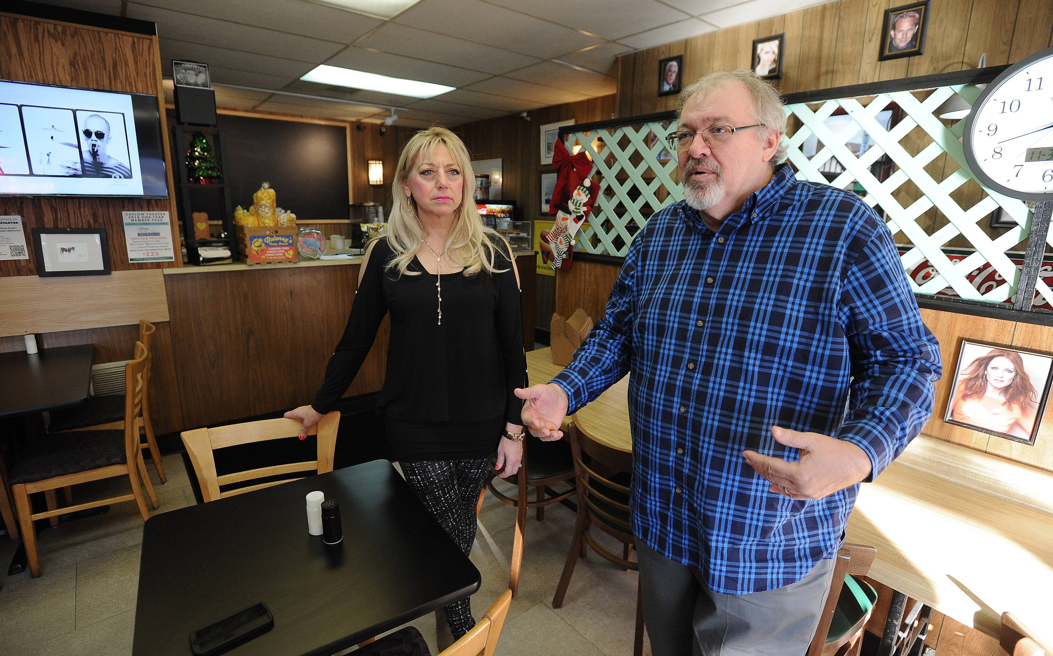 Tim O' Connor, owner of the Catlow Theater and the new adjacent Showtime Eatery in downtown Barrington, with his wife, Laura, in the restaurant. An online campaign fell well short of its goal in an effort to help finance proposed upgrades to Showtime.