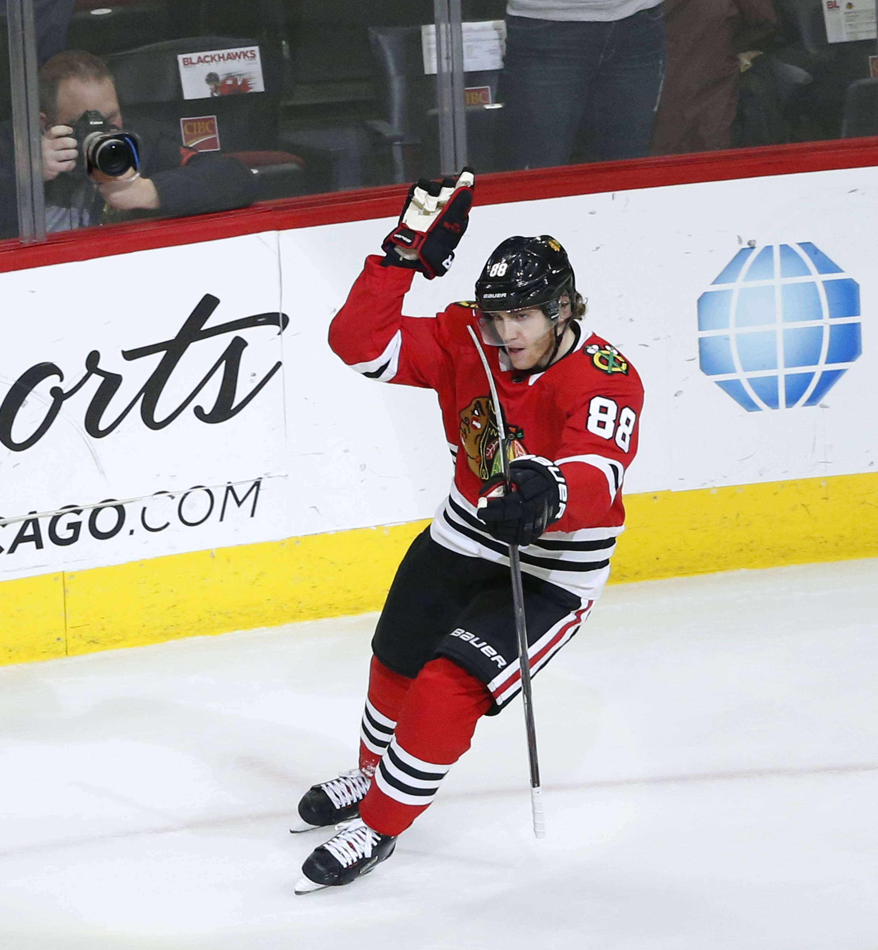 Chicago Blackhawks' Patrick Kane (88) celebrates his game winning goal during overtime of an NHL hockey game against the Florida Panthers, Tuesday, Dec. 12, 2017, in Chicago. The Blackhawks won 3-2. (AP Photo/Charles Rex Arbogast)