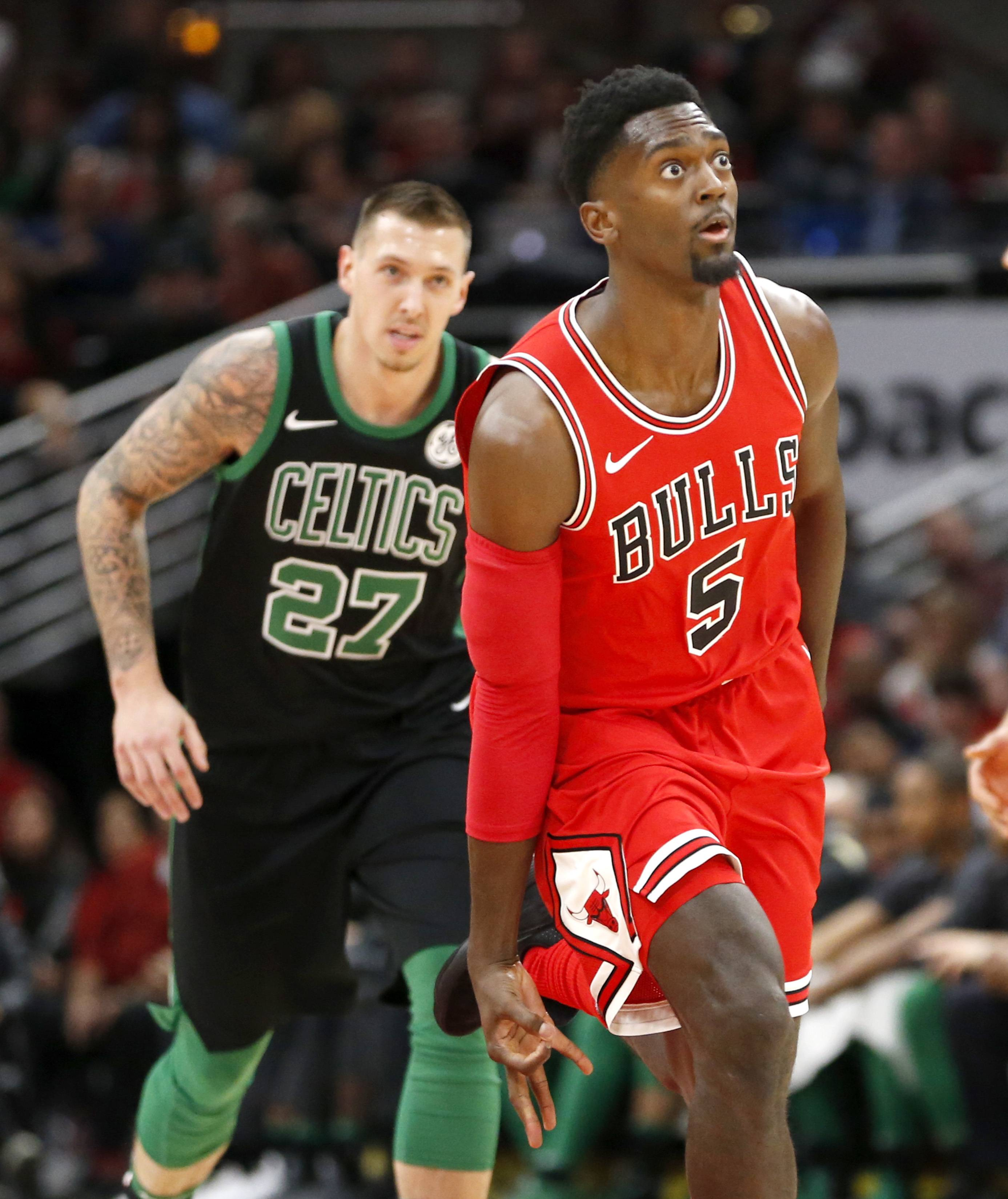 Chicago Bulls' Bobby Portis signals after his three-point basket as Boston Celtics' Daniel Theis follows during the first half of an NBA basketball game Monday, Dec. 11, 2017, in Chicago. (AP Photo/Charles Rex Arbogast)