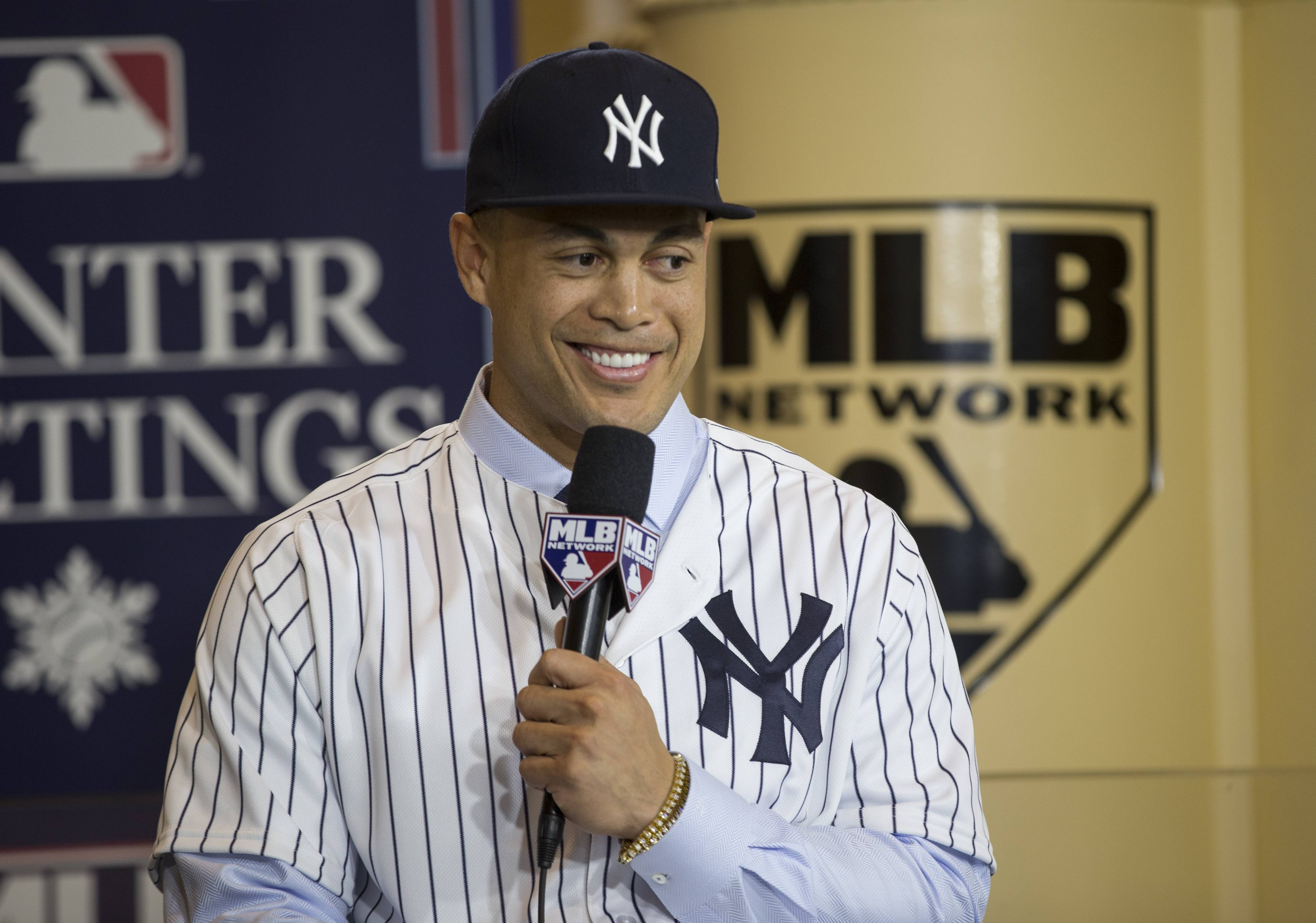 New Yankee Giancarlo Stanton answers questions during a press conference at the Major League Baseball winter meetings in Orlando, Fla., Monday, Dec. 11, 2017.