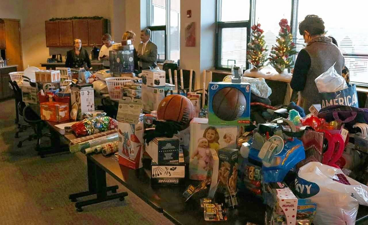 Hotel employees and others involved with the Hospitality Helps coalition in Naperville sort through donated wish list items to be given to 360 Youth Services in Naperville and Hesed House homeless services in Aurora as part of the coalition's first holiday drive.