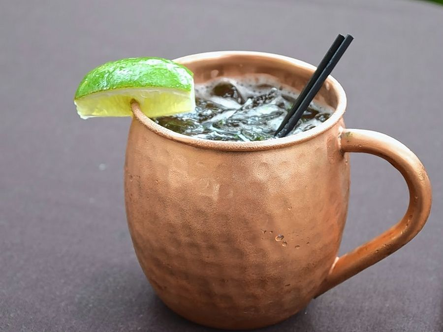 Tuscany's Holiday Mule features Tito's Vodka, pomegranate juice, lime juice, ginger beer and dash of honey with a lime garnish.