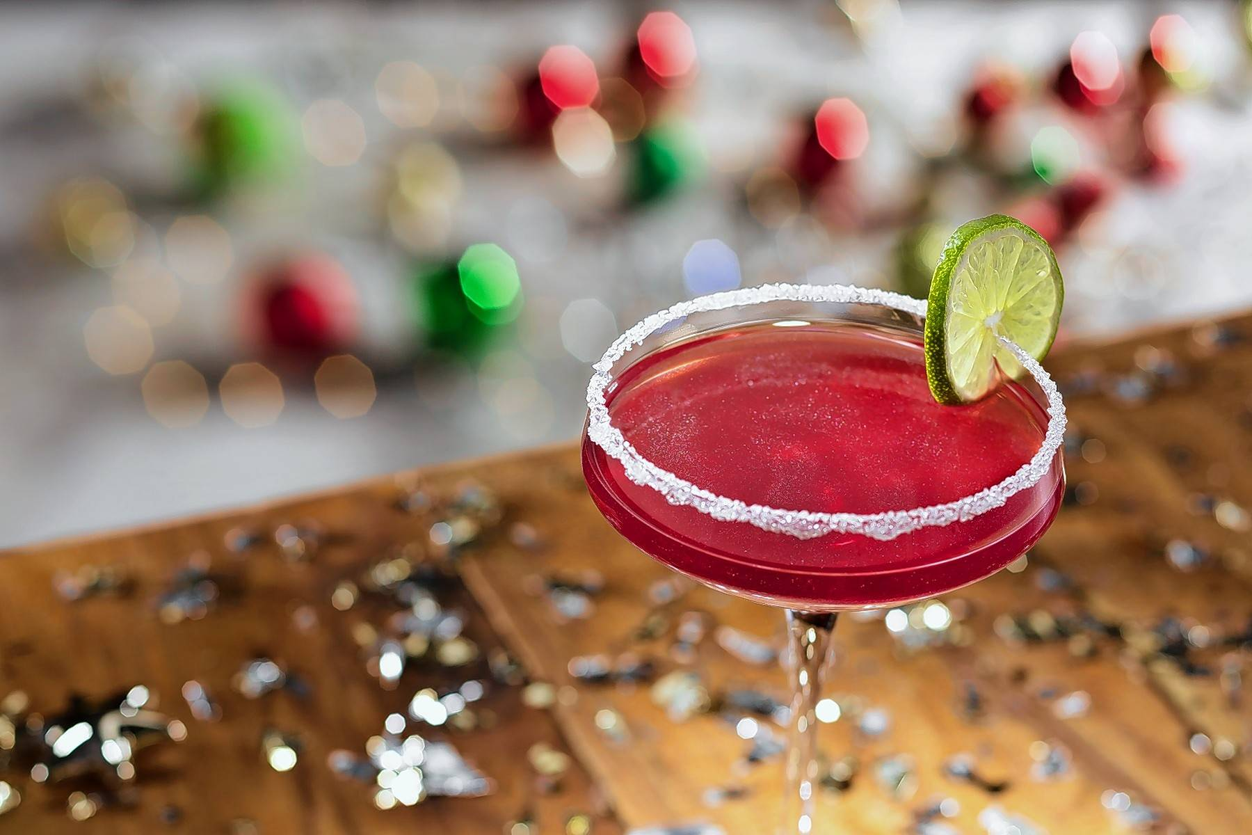 Olive Garden's Merry Cranberry is a blend of Deep Eddy Cranberry Vodka and amaretto shaken with cranberry-pomegranate juice and finished with glitter dust and a sugar rim.