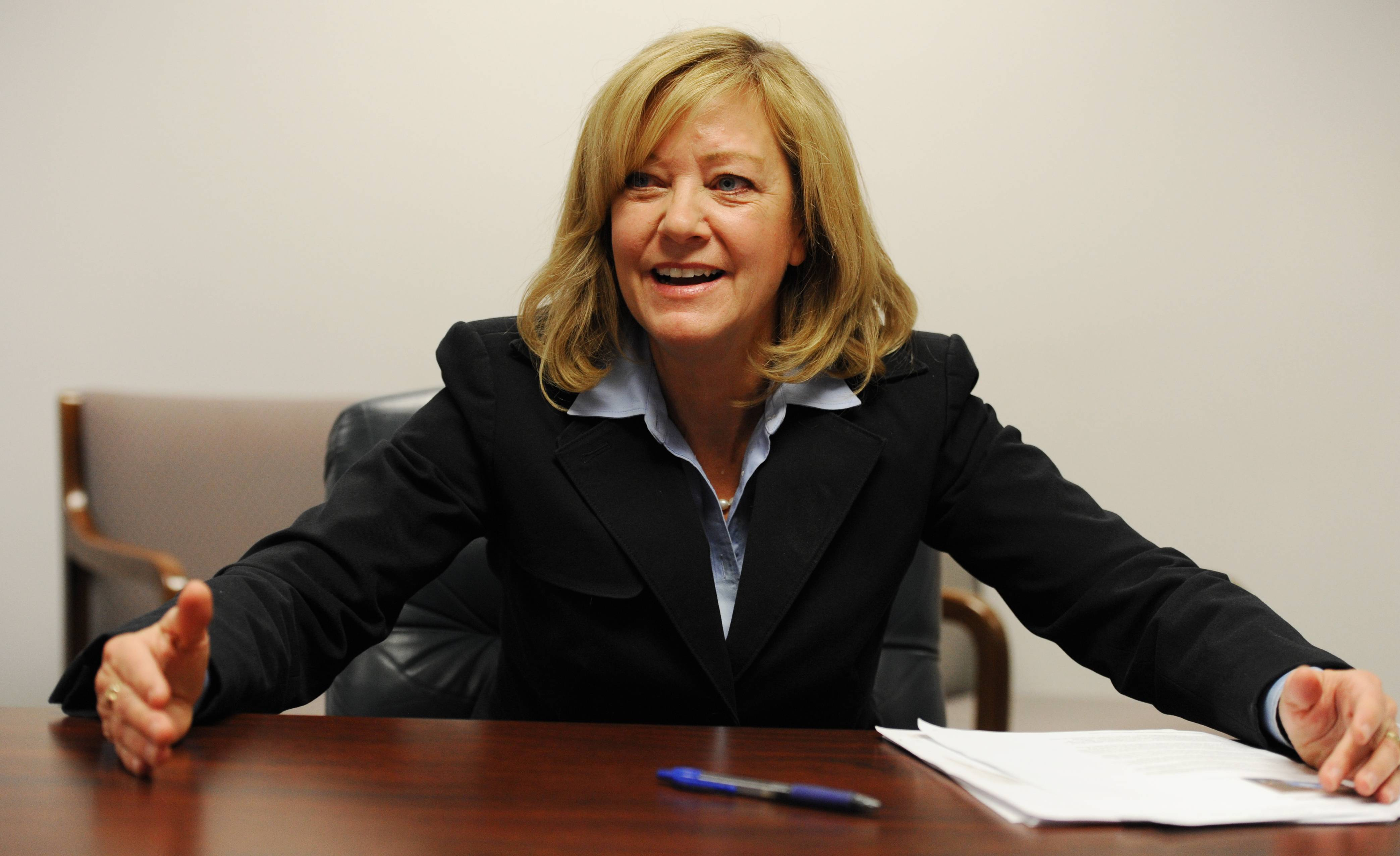 "Consolidating school districts, state Rep. Jeanne Ives stressed, wouldn't necessarily mean losing local traditions. ""It doesn't mean give up the school's mascot. It means the administration and all that goes up to the (larger) school district level,"" she said."