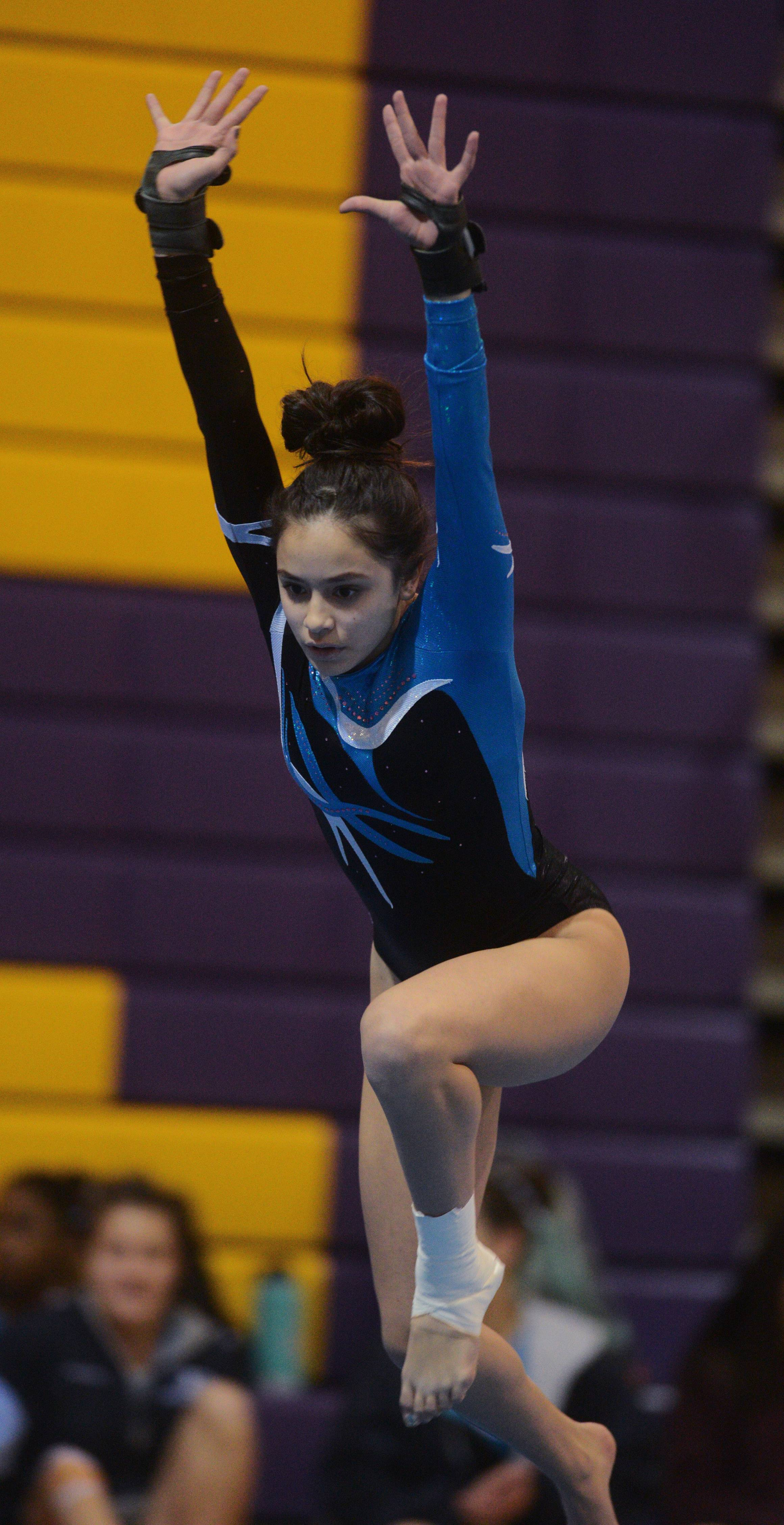 Prospect's Rosie Barros competes on floor exercise during Wednesday's gymnastics meet in Rolling Meadows.