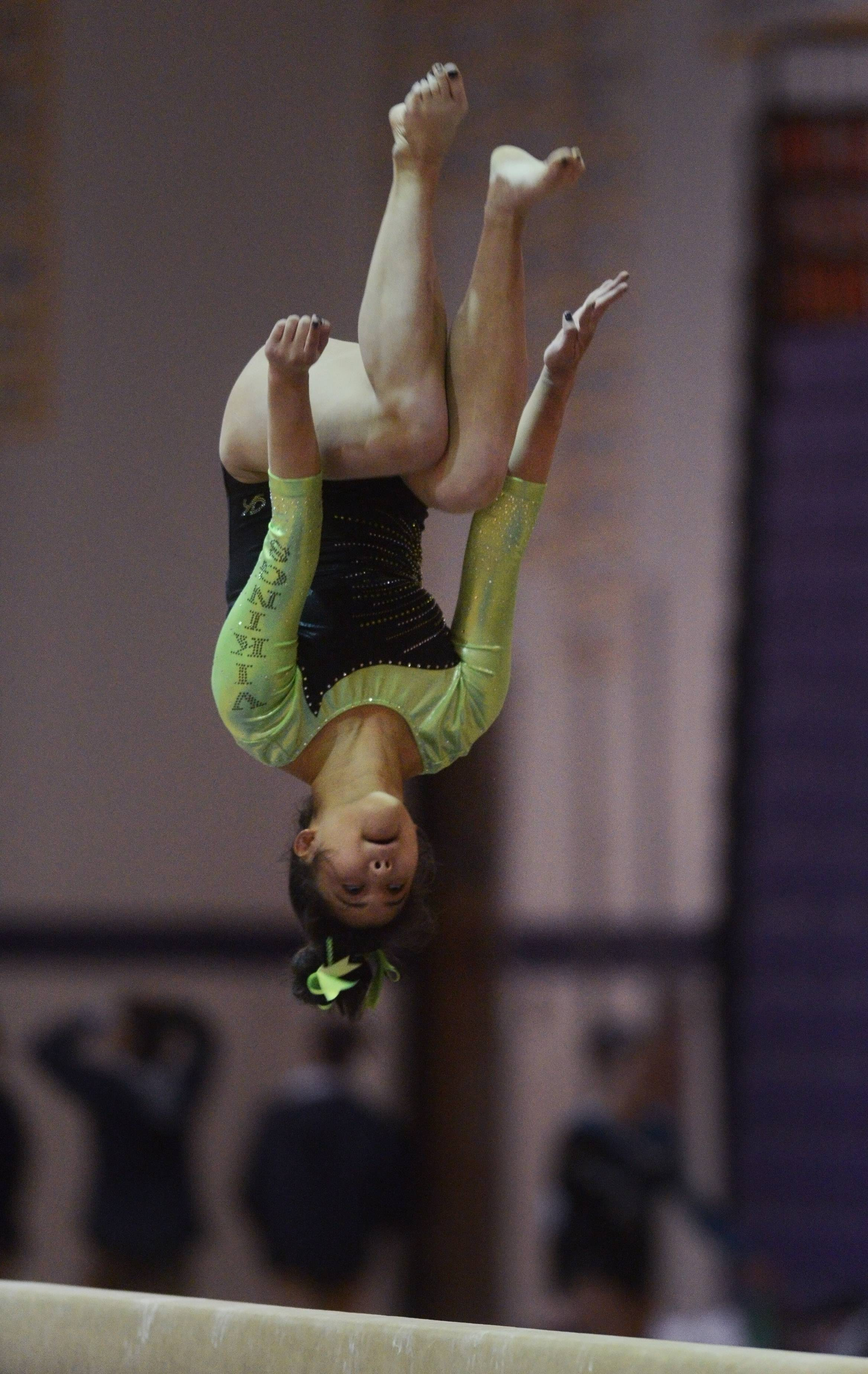 Fremd's Melanie Ng competes on the balance beam during Wednesday's gymnastics meet at Rolling Meadows.