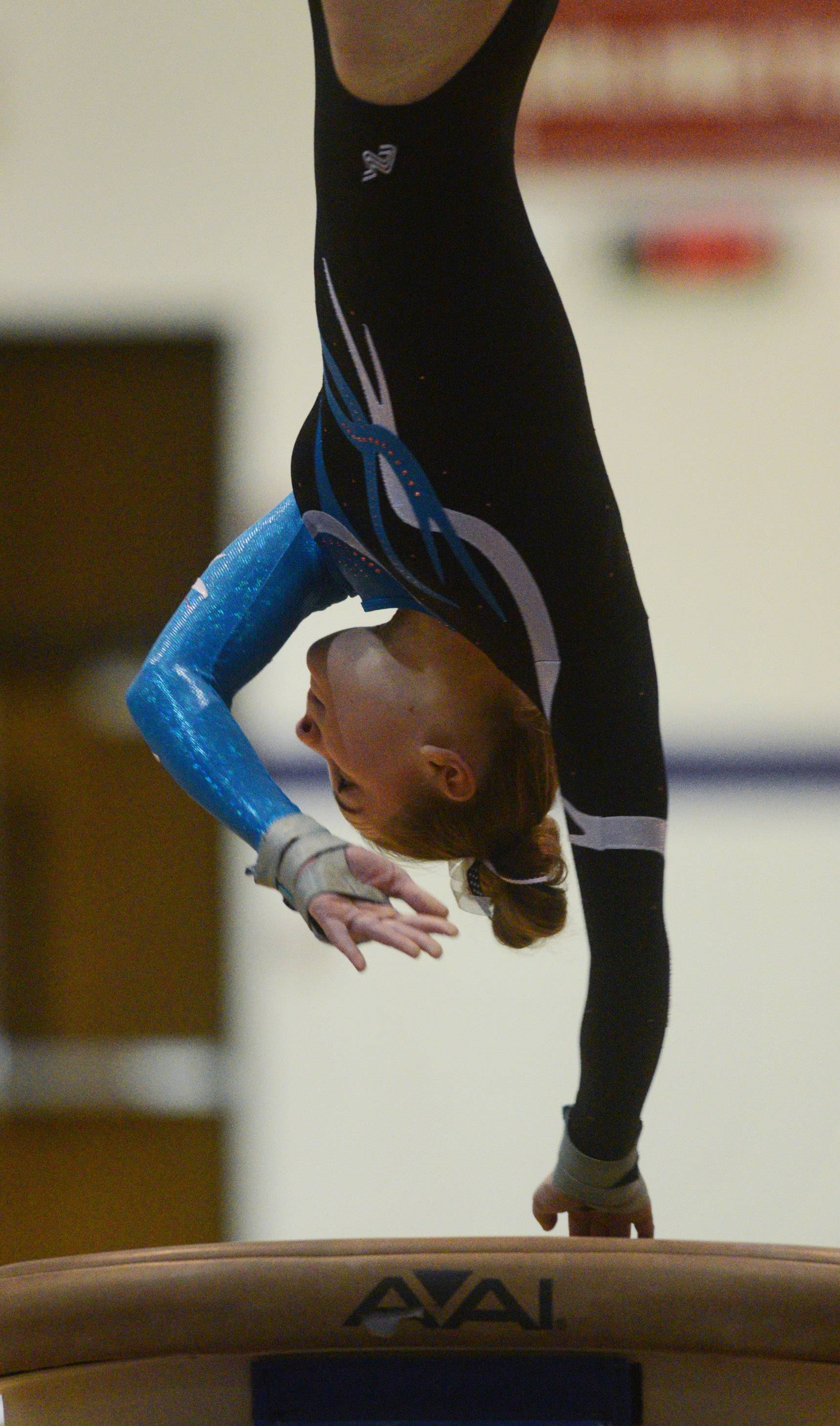 Prospect's Jillian Schmit competes on vault during Wednesday's gymnastics meet in Rolling Meadows.