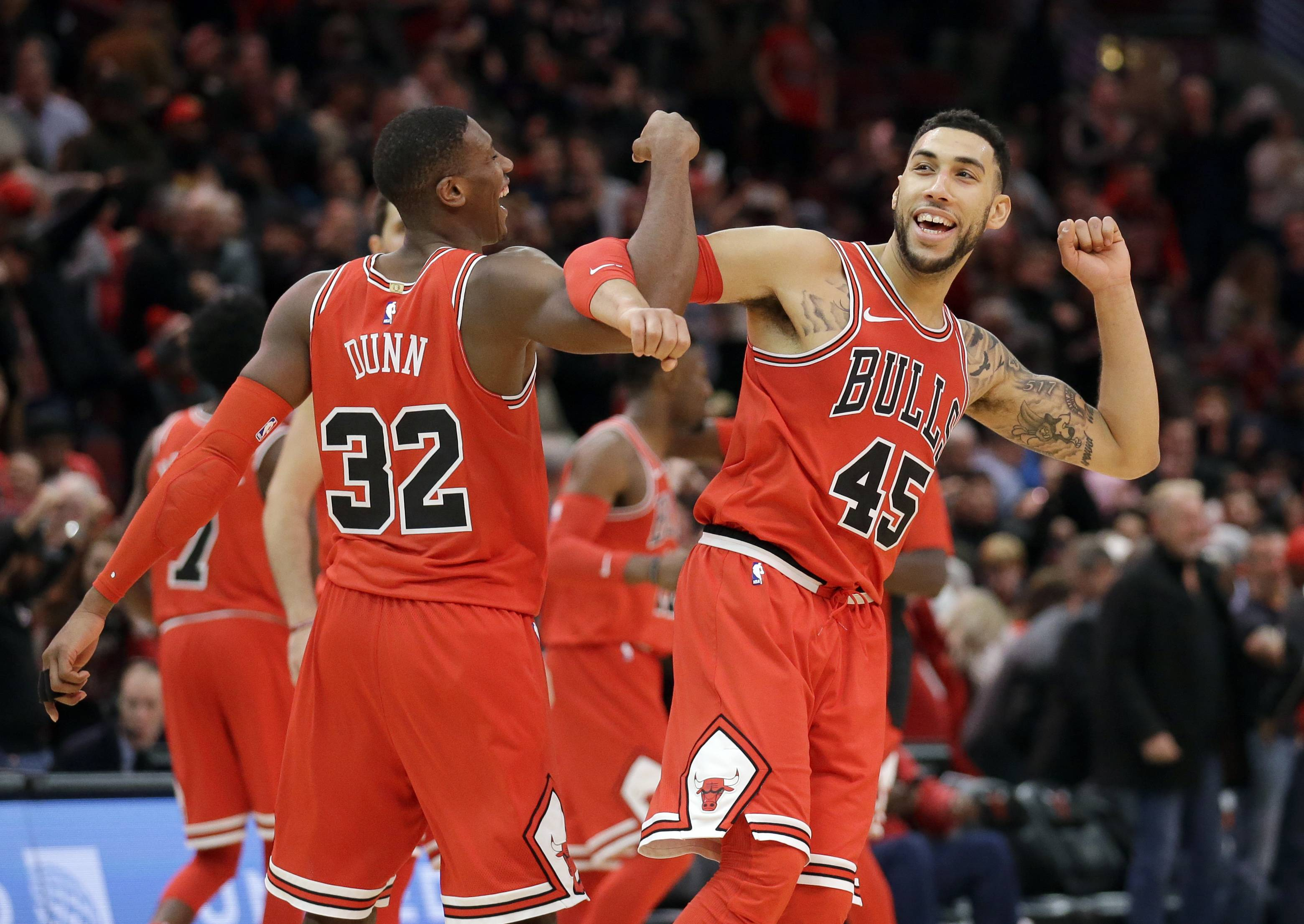 Chicago Bulls guard Kris Dunn, left, celebrates with Denzel Valentine after the Chicago Bulls defeated the Utah Jazz 103-100 in an NBA basketball game Wednesday, Dec. 13, 2017, in Chicago.
