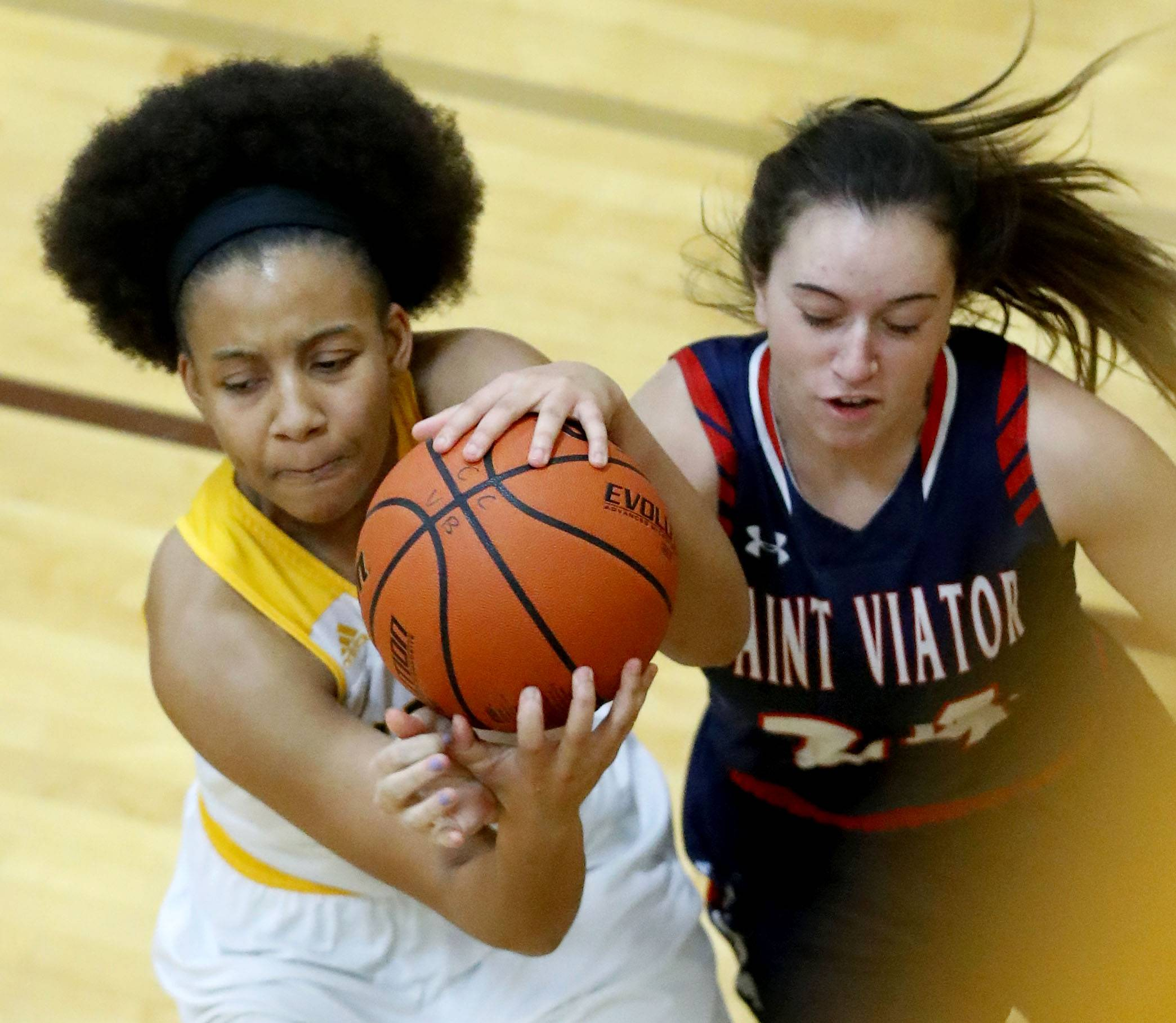 Carmel's Shai Horton, left, and St. Viator's Haley Robinson battle for a rebound.