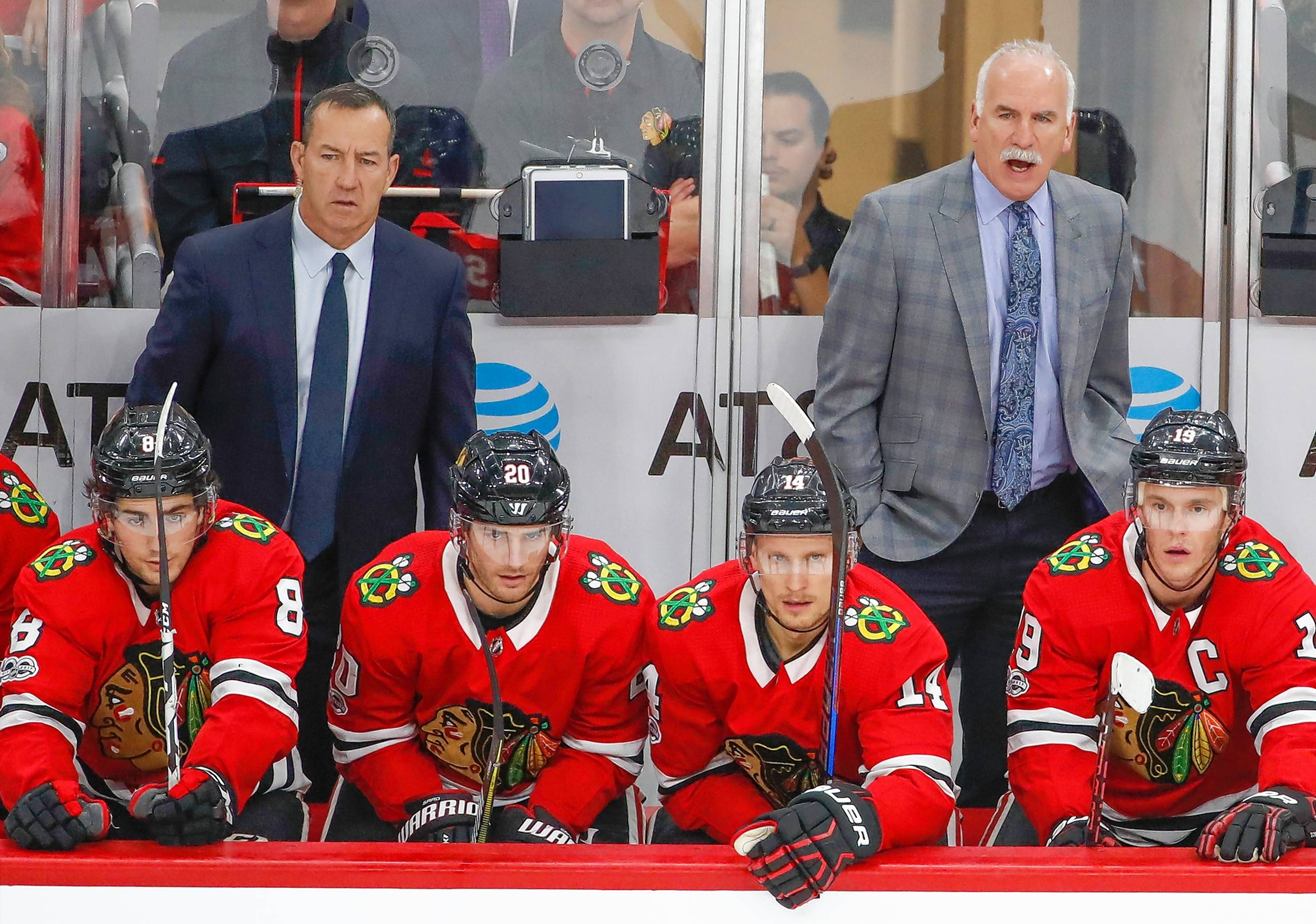 Chicago Blackhawks head coach Joel Quenneville, back right, yells to his team during the third period of an NHL hockey game against the New Jersey Devils Sunday, Nov. 12, 2017, in Chicago.