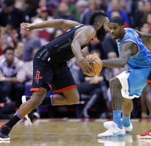 Houston Rockets guard James Harden (13) drives around Charlotte Hornets  guard Michael Carter- e40ea01cf