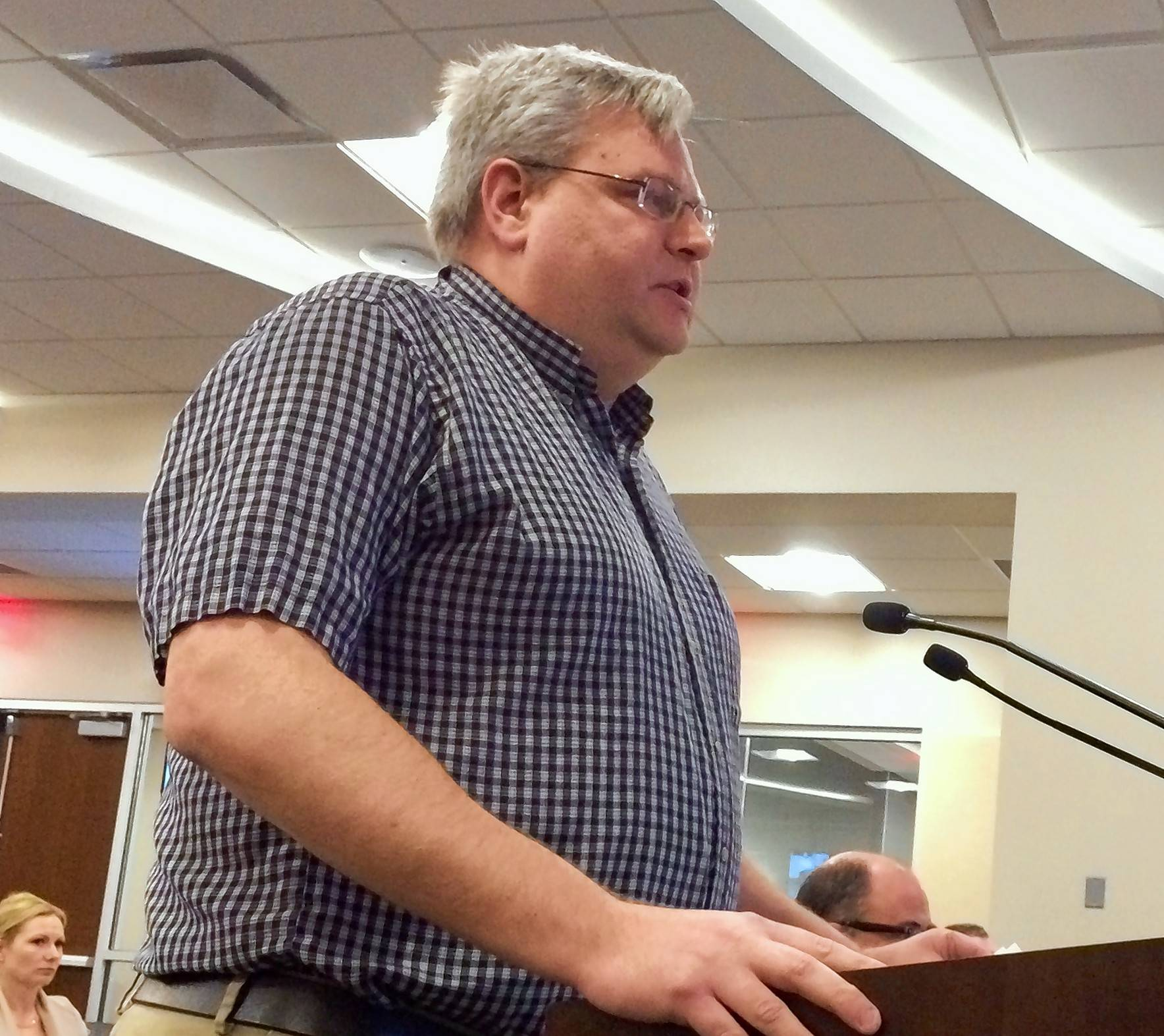 Dr. David Luttrell, owner of Palatine Animal Hospital, speaks at this week's village council meeting. He expressed opposition to an animal clinic that would have opened near his Northwest Highway facility.