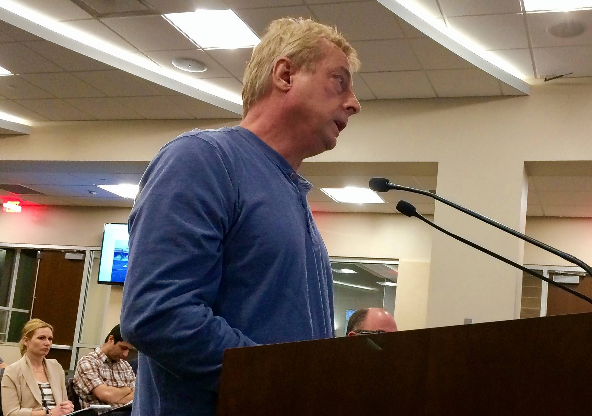 Dr. Peter Lysakowski, owner of Rand Road Animal Hospital in Palatine, speaks at this week's village council session.