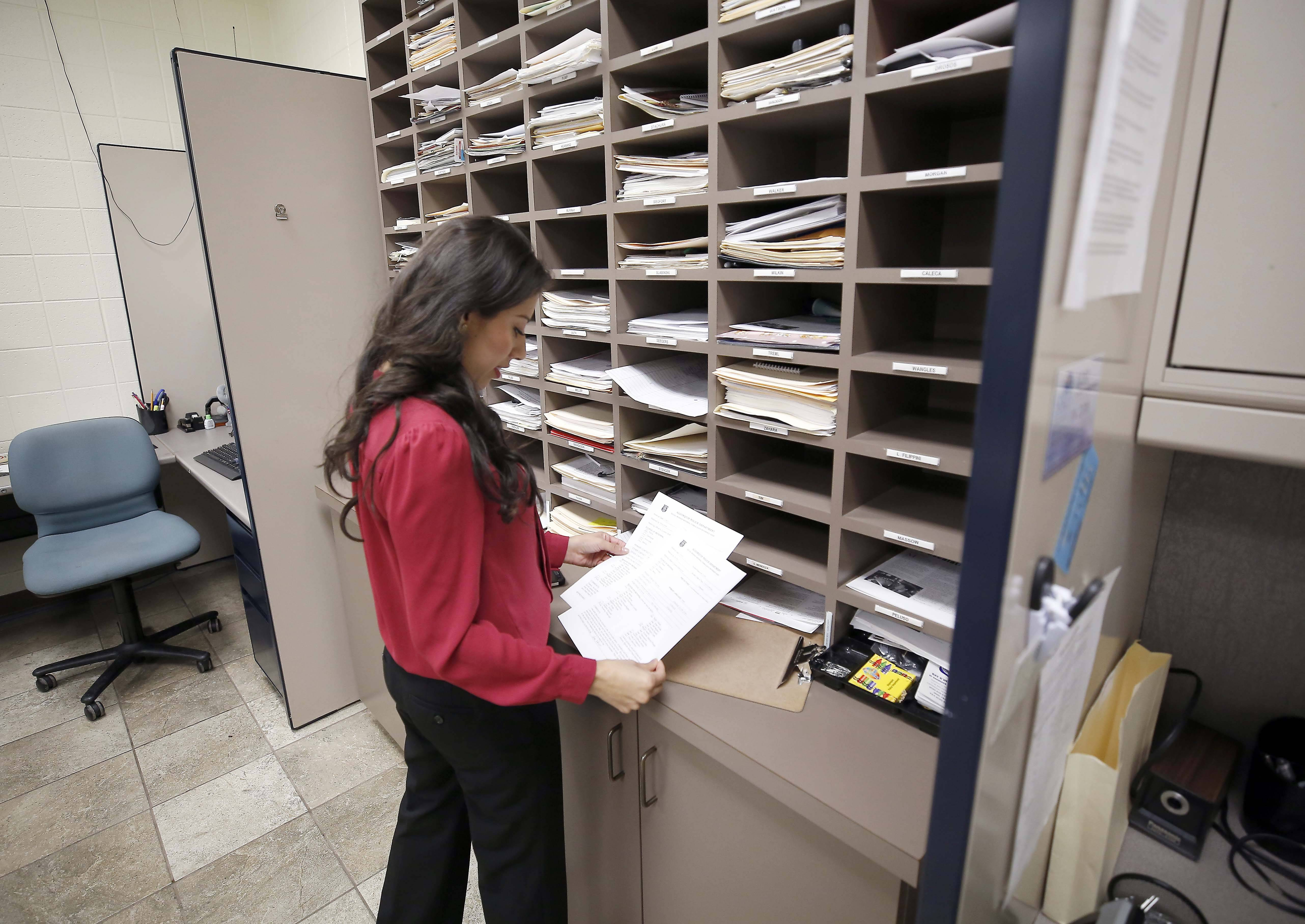 Case worker Cristina Mendoza of the Aurora-based Association for Individual Development assesses needs and identifies resources for individuals referred to her by police departments in McHenry County.