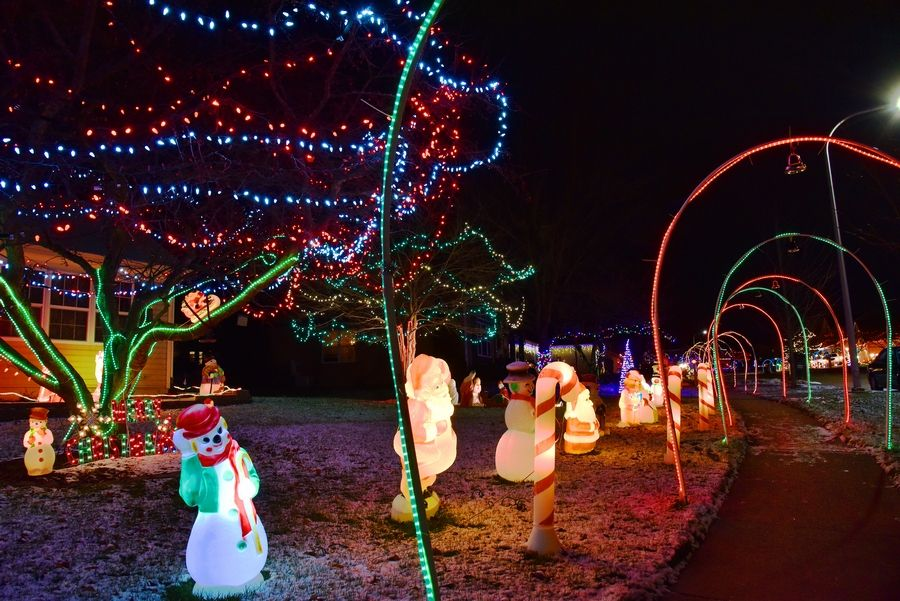 Arches of lights cover the sidewalks for Christmas on Juniper Lane in South Elgin.