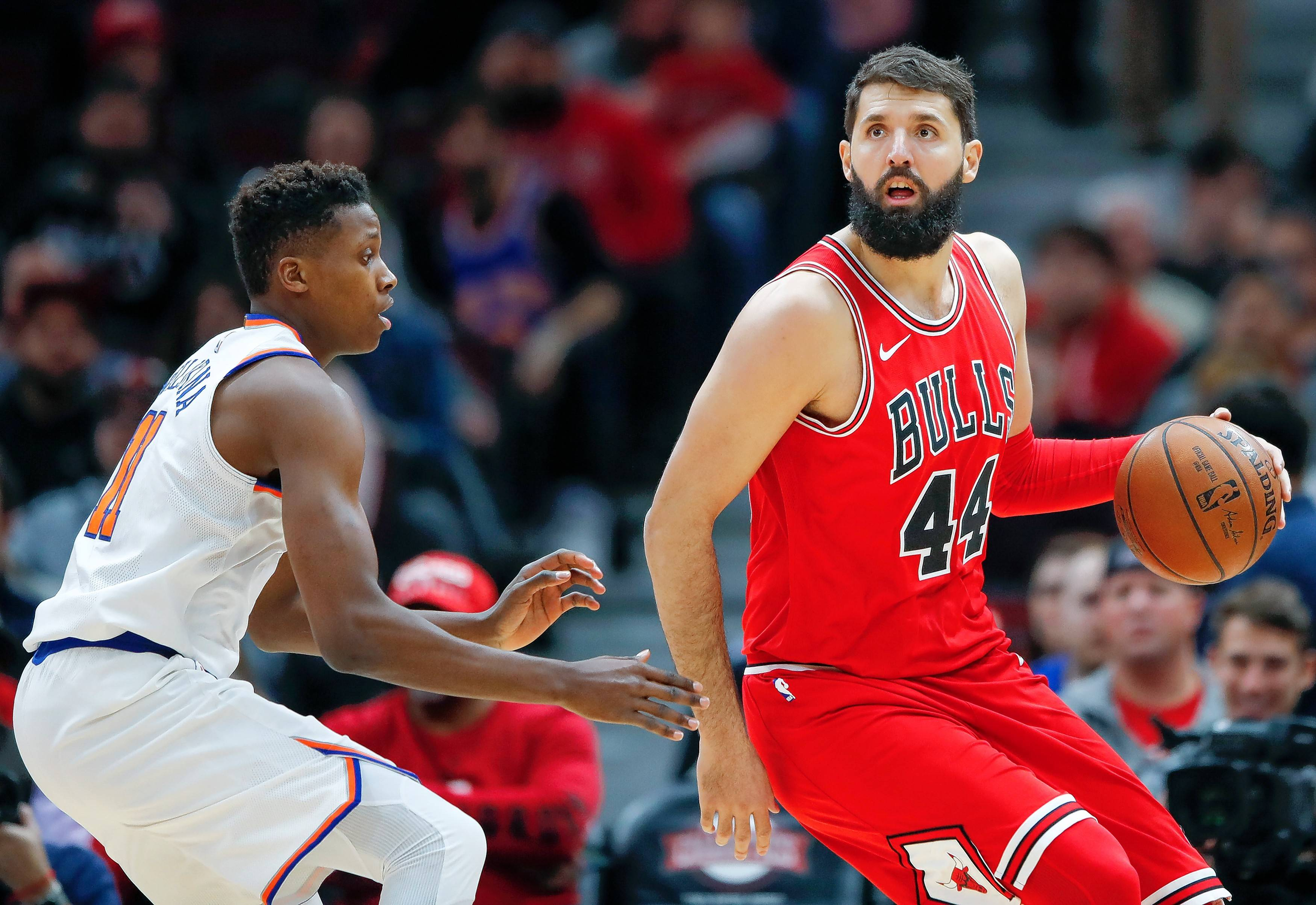 Chicago Bulls forward Nikola Mirotic (44) is defended by New York Knicks guard Frank Ntilikina (11) during the first half of an NBA basketball game, Saturday, Dec. 9, 2017, in Chicago. (AP Photo/Kamil Krzaczynski)