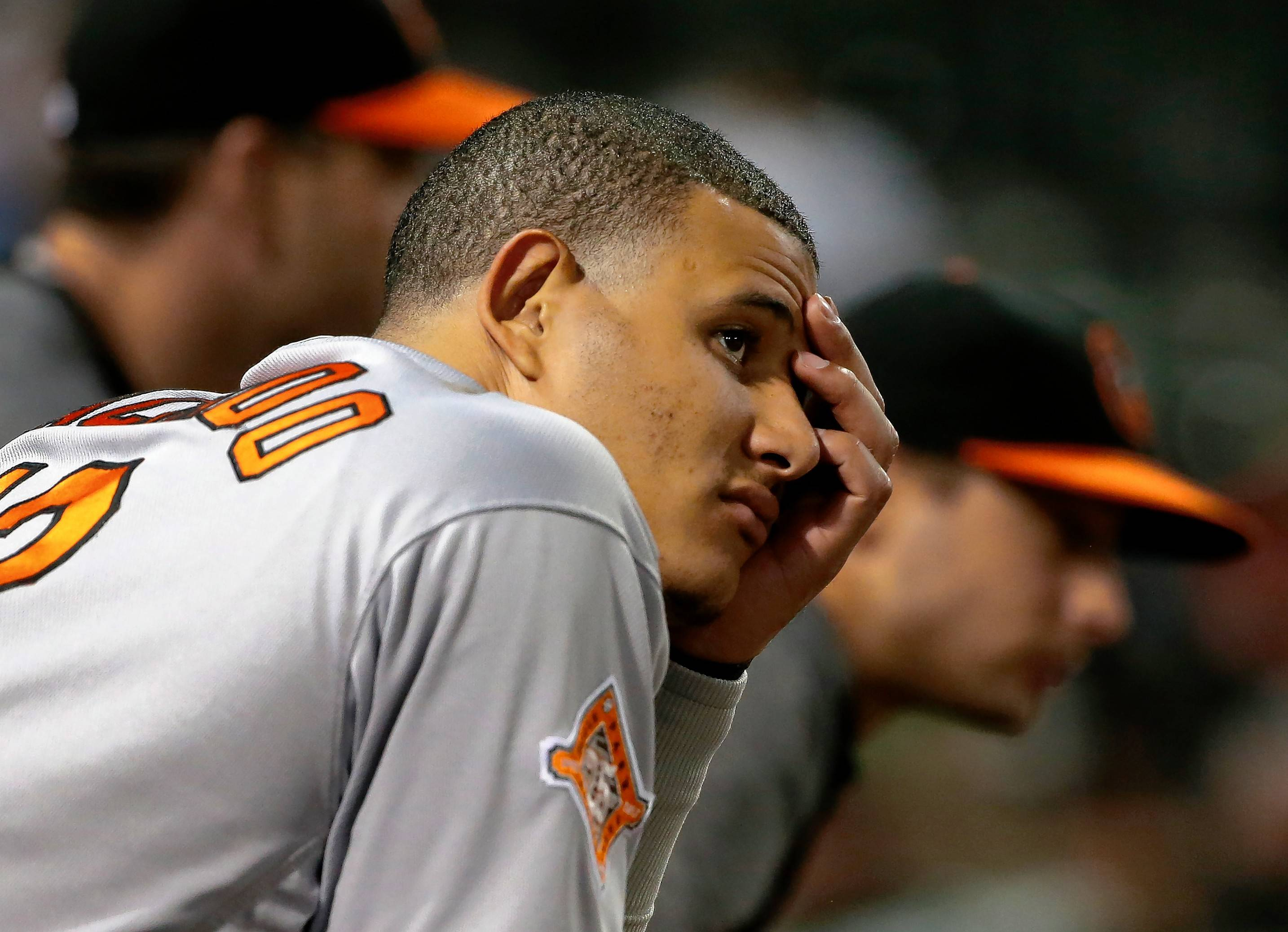 Baltimore Orioles third baseman Manny Machado, left, will become a free agent after the 2018 season, and the Orioles are considering trade offers for him.