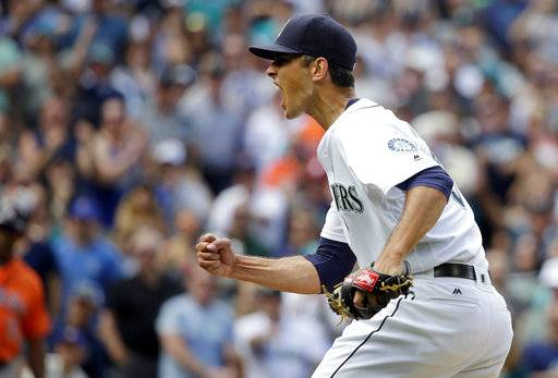 FILE - In this July 16, 2016, file photo, Seattle Mariners closing pitcher Steve Cishek pumps his fist after the final out of a 1-0 win over the Houston Astros in a baseball game in Seattle. Cishek earned the save as the A person familiar with the negotiations says side-arming reliever Steve Cishek and the Chicago Cubs have agreed to a two-year contract. The person spoke to The Associated Press on condition of anonymity Thursday, Dec. 14, 2017, because the deal was subject to a successful physical and had not been announced. (AP Photo/Ted S. Warren, File)
