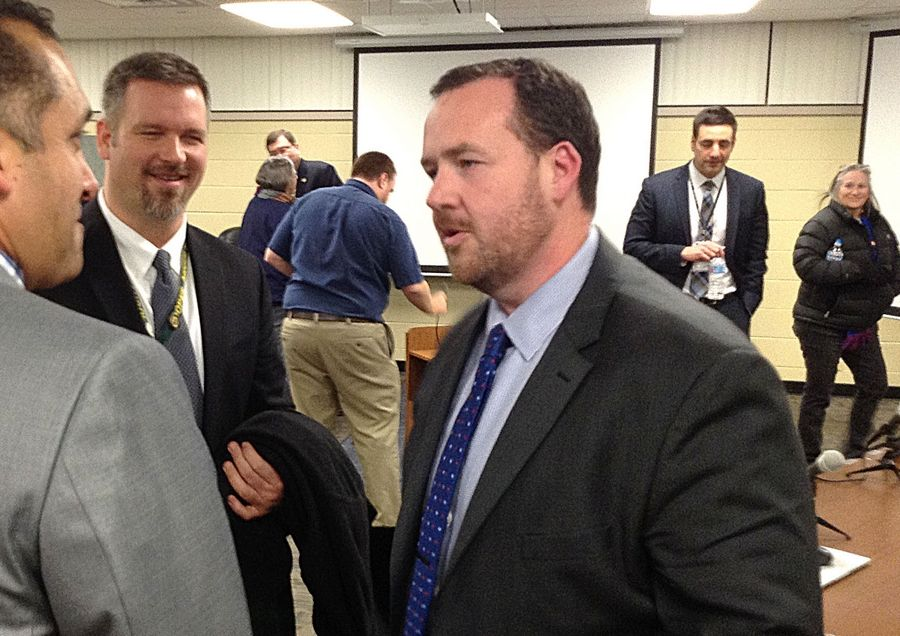 Incoming Wheeling Township Elementary District 21 Superintendent Michael Connolly, right, talks with London Middle School Principal Luis Correa, left, and Cooper Middle School Principal Bob Gurney after a school board meeting Thursday night.