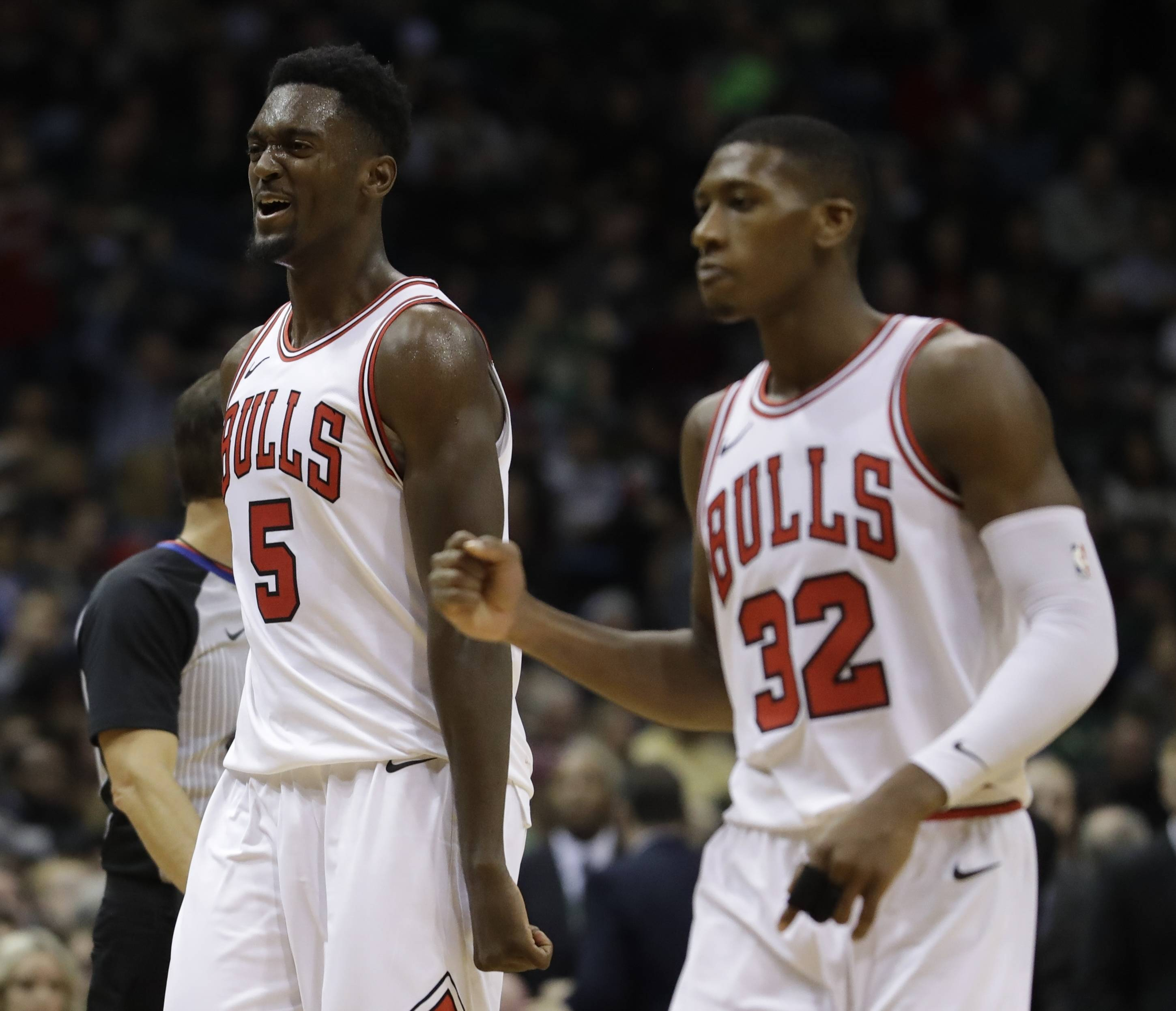 Chicago Bulls' Bobby Portis (5) and Kris Dunn celebrate in the final minutes against the Milwaukee Bucks Friday in Milwaukee. The Bulls won 115-109, running the team's win streak to 5.