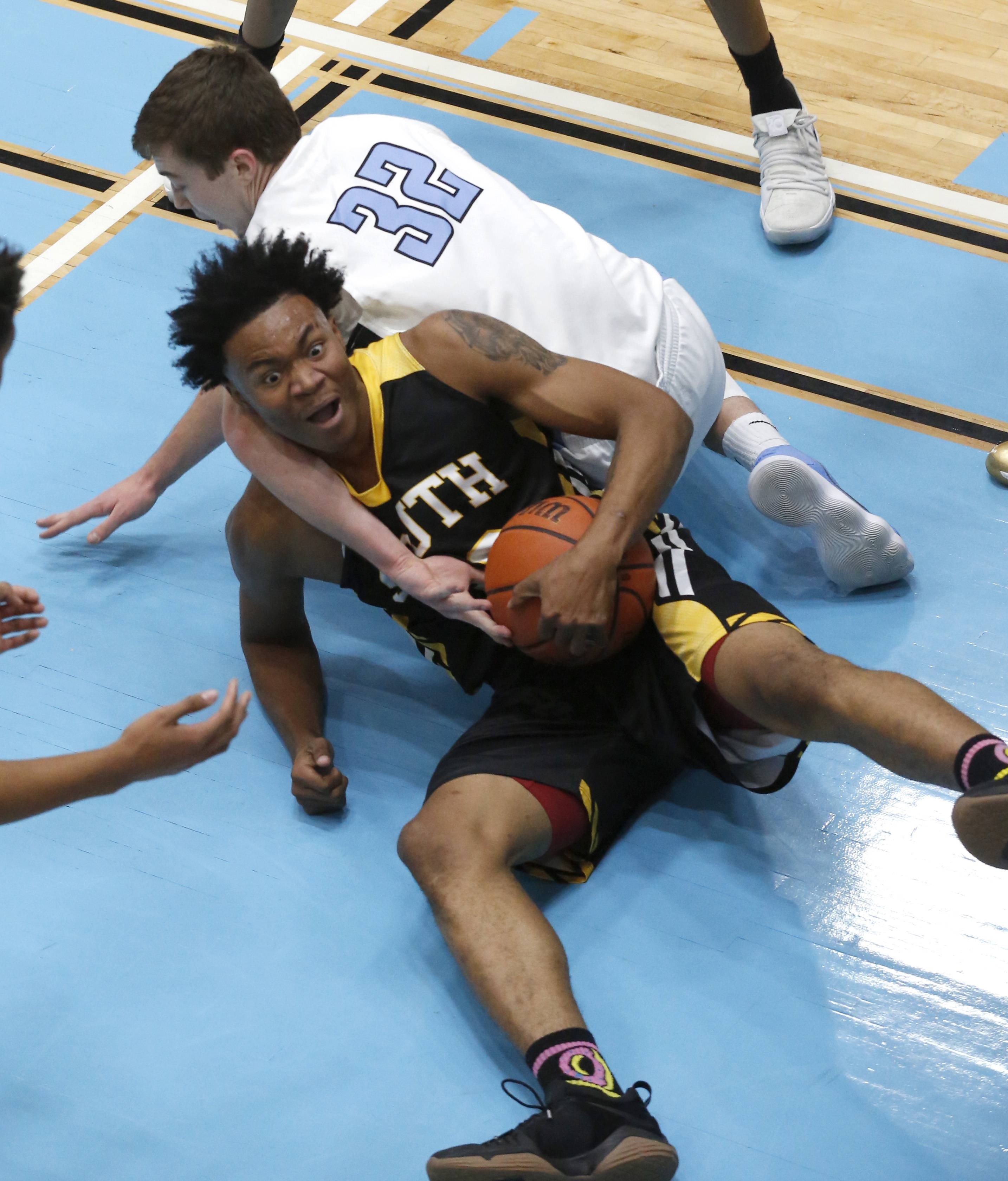 Hinsdale South's Zion Griffin calls for a time out while keeping the ball away from Willowbrook's Ethan Scheumer.