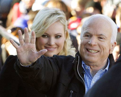 "CORRECTS YEAR TO 2008 FILE - In this Oct. 30, 2008 file photo, Republican presidential candidate Sen. John McCain, R-Ariz., accompanied by his daughter Meghan McCain, waves to supporters as he enters a campaign rally in Defiance, Ohio. Former Vice President Joe Biden sought to console the daughter of ailing Sen. John McCain after she began crying while discussing her father's cancer on ABC's ""The View.� McCain is battling the same aggressive type of brain cancer that killed Biden's son Beau in 2015. (AP Photo/Stephan Savoia)"