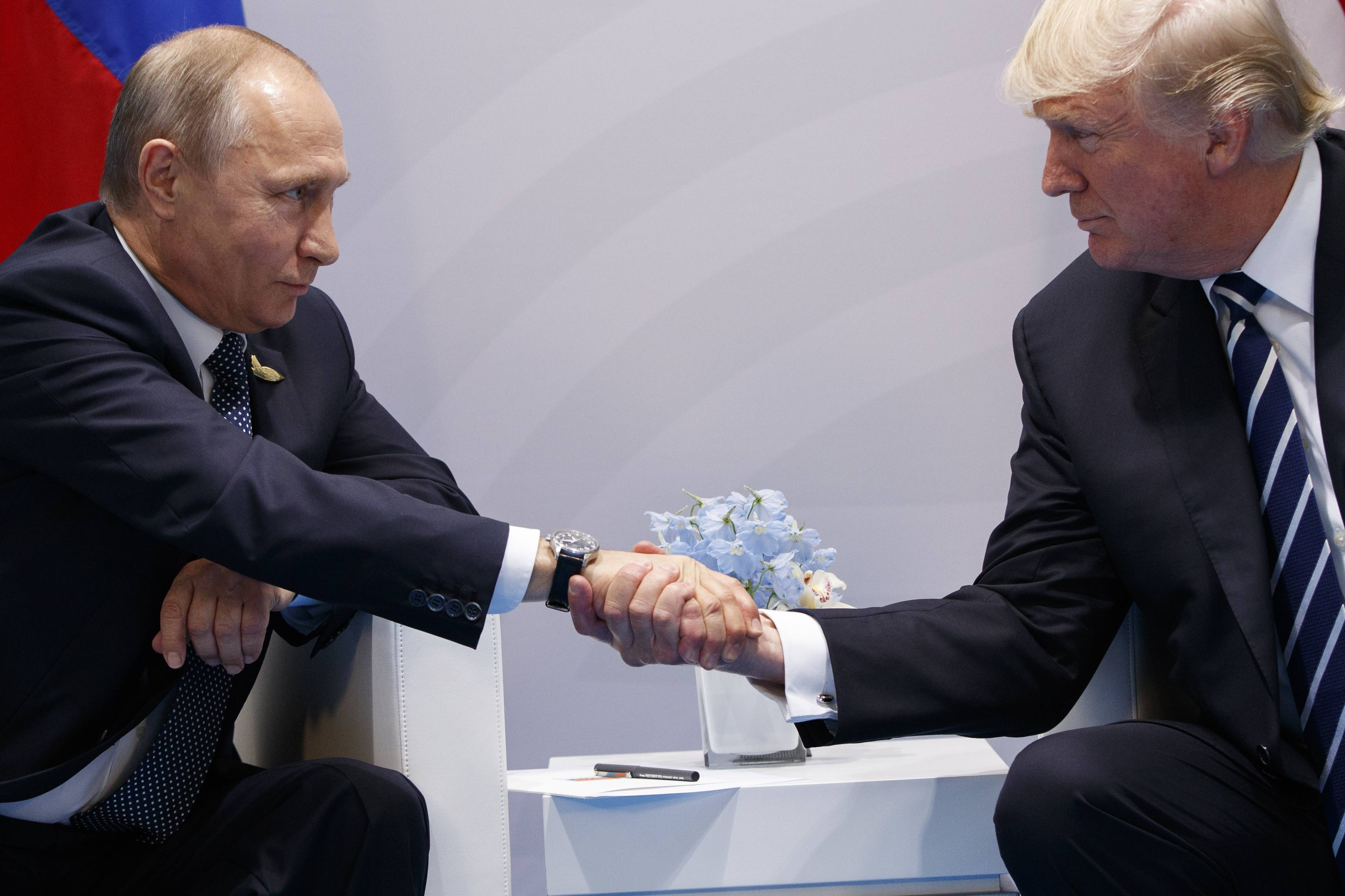 President Donald Trump shakes hands with Russian President Vladimir Putin at the G-20 Summit last July 7.