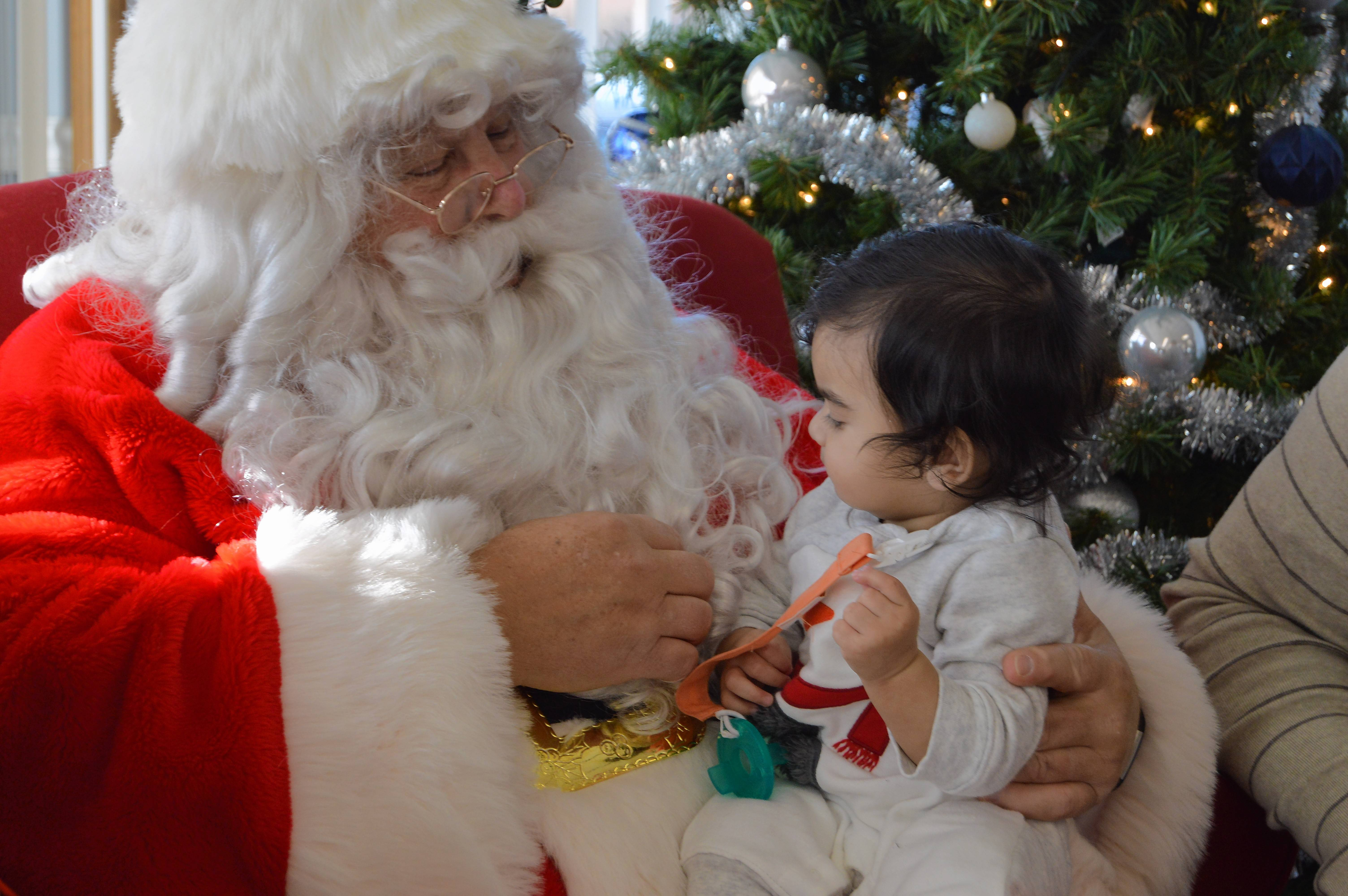 Santa Claus confers with a young believer Saturday during Mundelein Park and Recreation District's Breakfast with Santa.