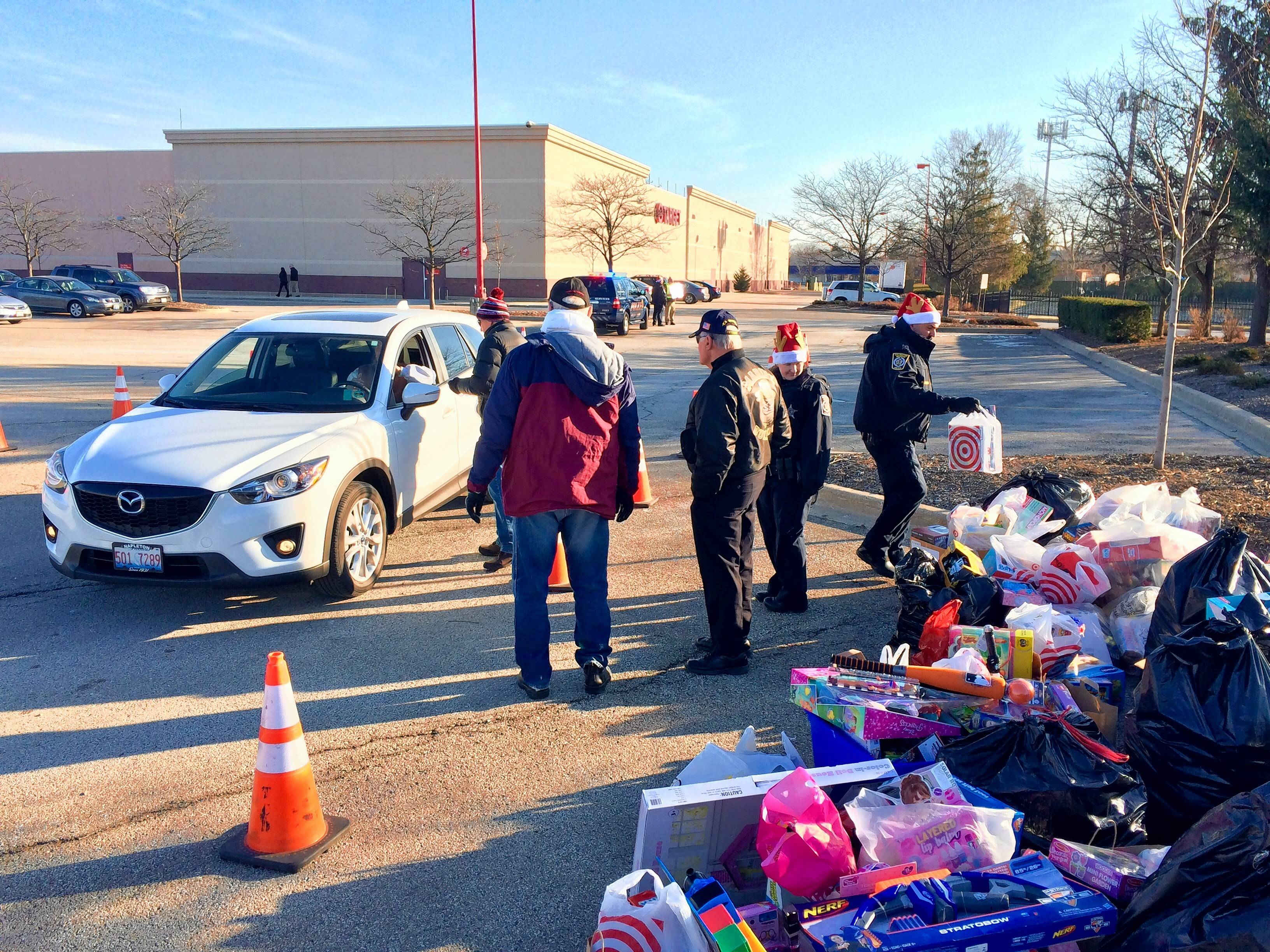 Arlington Heights police hosted their inaugural drive-through Toys for Tots collection Saturday in the Target parking lot off Rand Road.