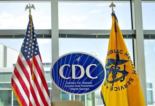 "FILE - This Nov. 19, 2013 file photo shows a Centers for Disease Control and Prevention logo at the agency's federal headquarters in Atlanta. Reacting to a Friday, Dec. 15, 2017 story in The Washington Post, health leaders say they are alarmed that officials at the CDC, the nation's top public health agency, are being told not to use certain words or phrases in official budget documents, including ""fetus,"" ''transgender"" and ""science-based."" (AP Photo/David Goldman, File)"