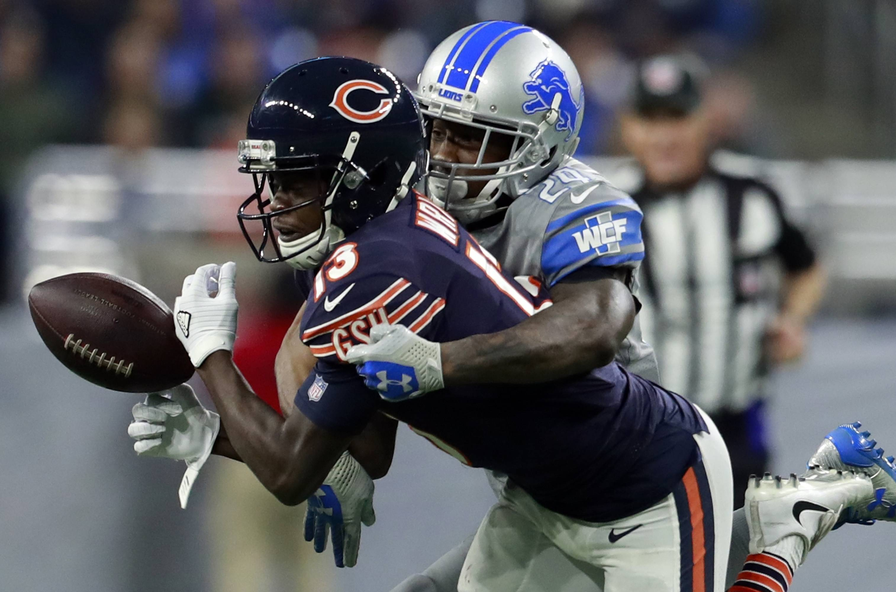 Detroit Lions cornerback Nevin Lawson (24) deflects a pass intended for Chicago Bears wide receiver Kendall Wright (13) during the second half of an NFL football game, Saturday, Dec. 16, 2017, in Detroit. (AP Photo/Rey Del Rio)